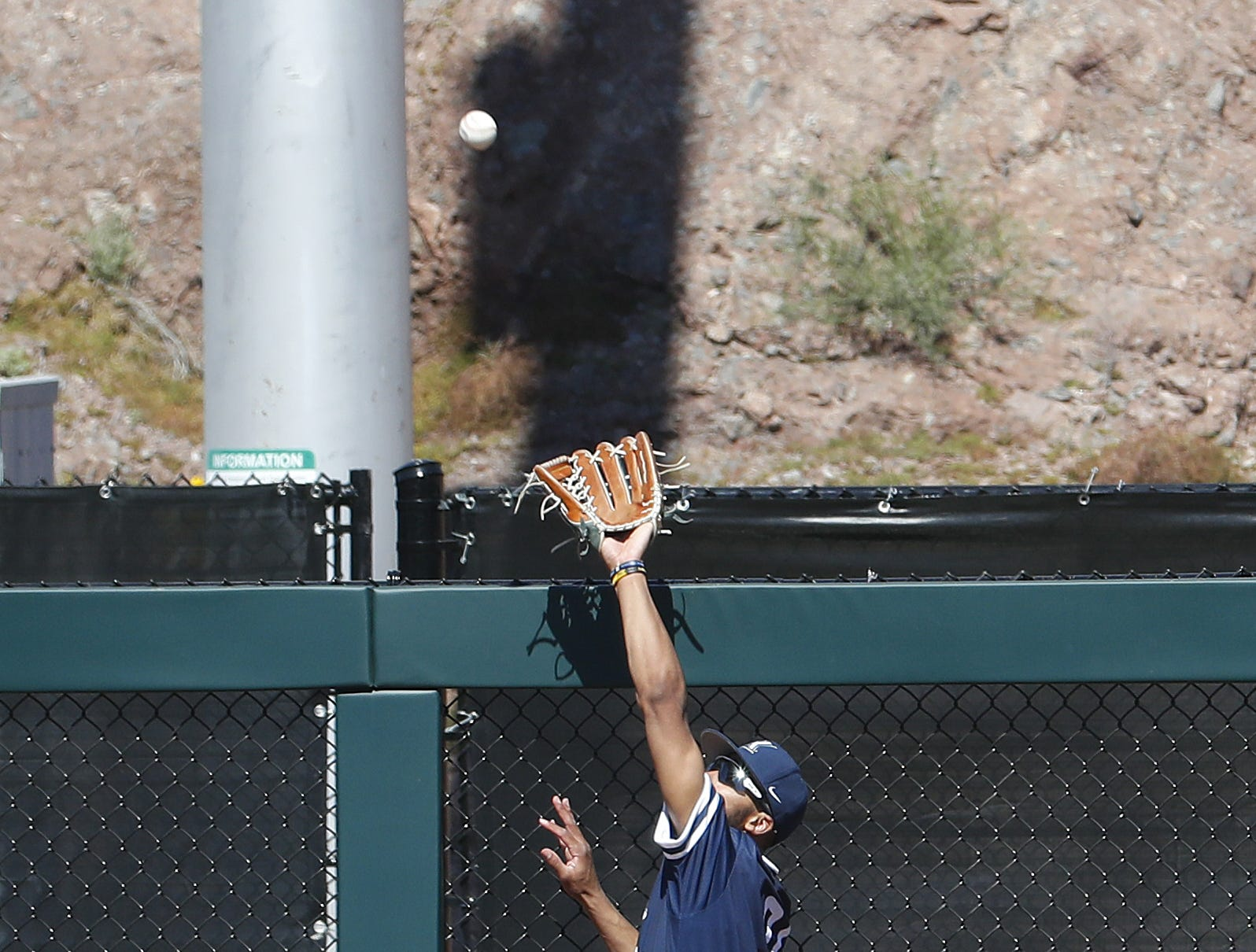 Xavier's Allbry Major (34) makes a catch at the wall robbing a home run against ASU at Phoenix Municipal Stadium in Phoenix, Ariz. on March 10, 2019.