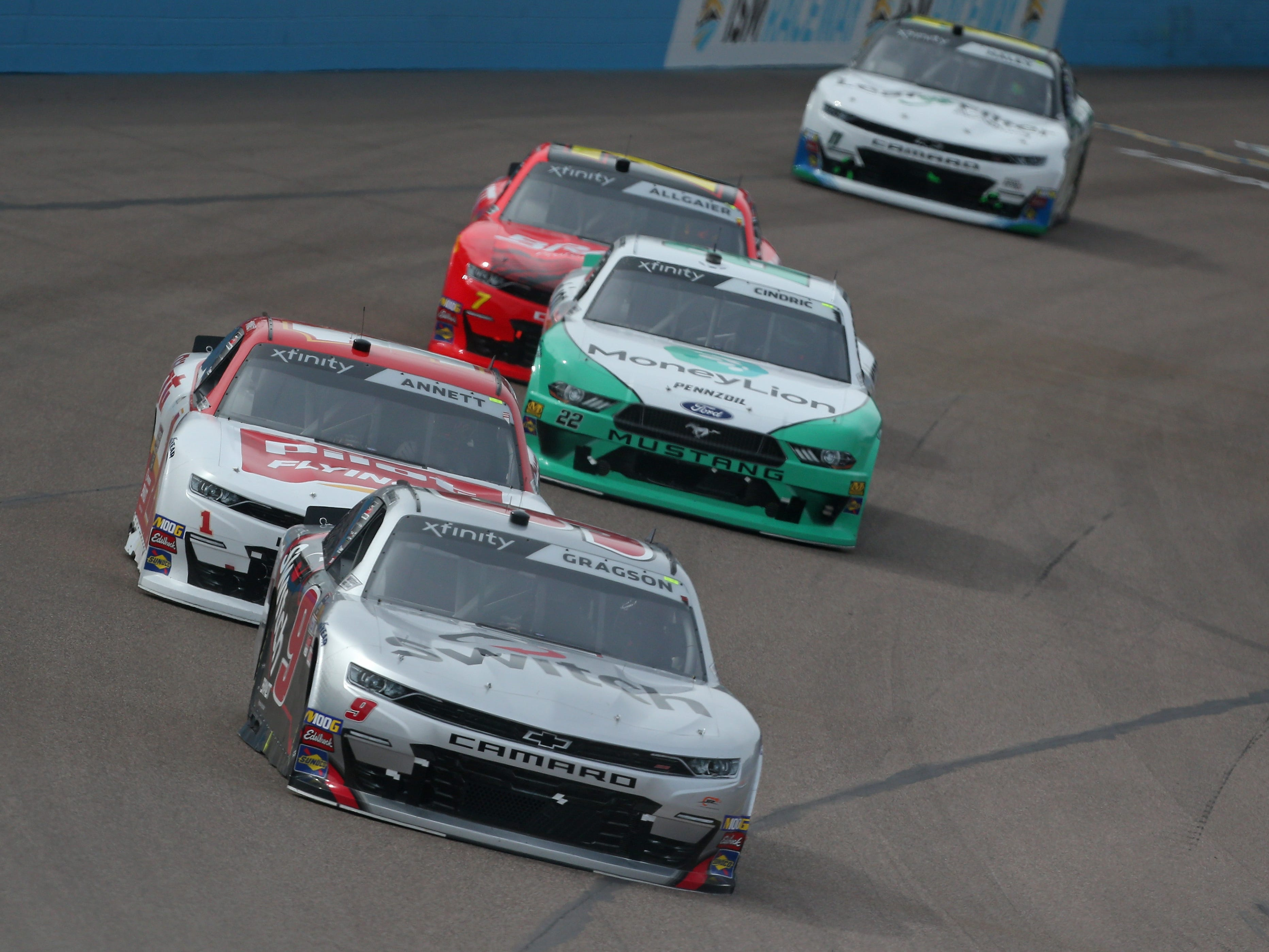 AVONDALE, AZ - MARCH 09:  Noah Gragson, driver of the #9 Switch Chevrolet, leads a pack of cars during the NASCAR Xfinity Series iK9 Service Dog 200 at ISM Raceway on March 9, 2019 in Avondale, Arizona.