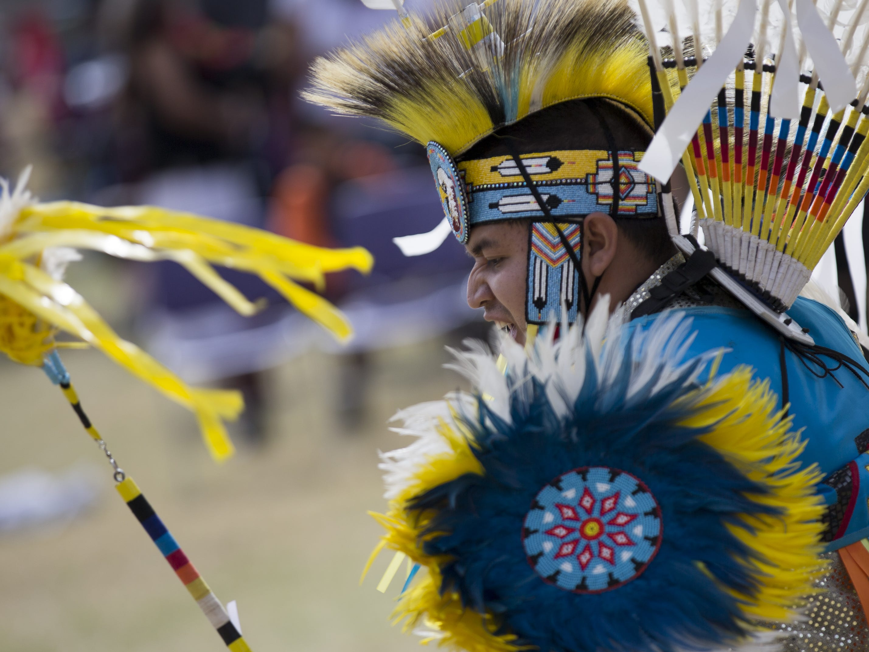 Cody Thompson performs a feather dance at the Native Two Spirit Powwow at South Mountain Community College in Phoenix, Ariz. on Saturday, March 9, 2019. The powwow was the first of its kind in Arizona, featuring members who identified as two spirit, and members who did not, dancing together.