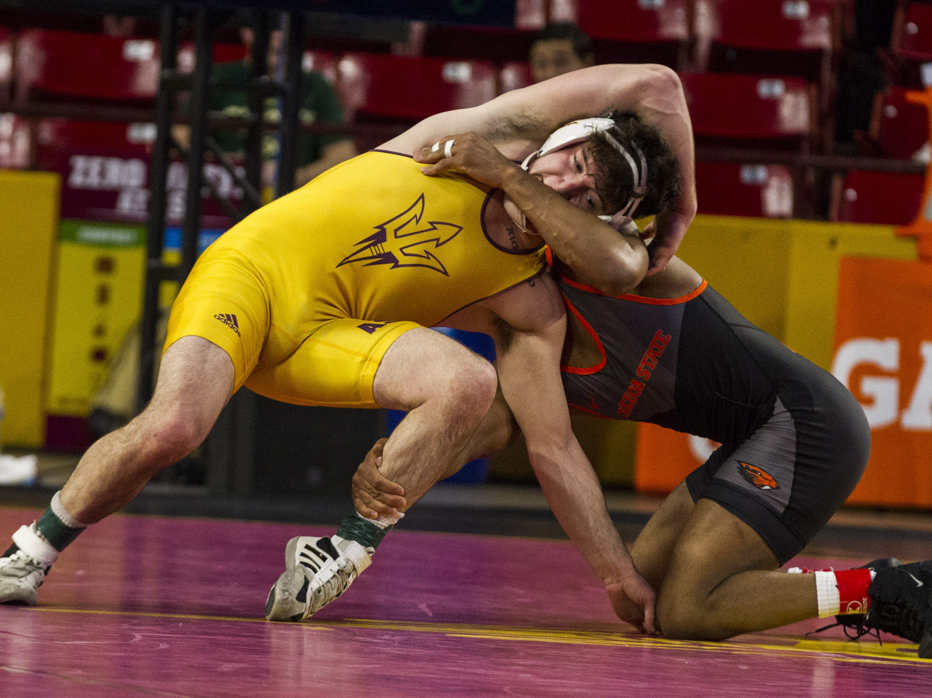 ASU's Josiah Kline grapples with Oregon State's Devan Turner in the 133 pounds weight class at Wells Fargo Arena in Tempe on March 9, 2019.