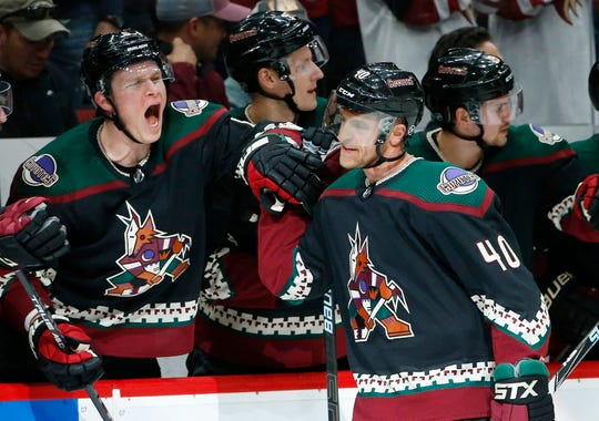 Arizona Coyotes right wing Michael Grabner (40) celebrates his goal against the Los Angeles Kings with Coyotes' Jakob Chychrun, left, during the first period of an NHL hockey game Saturday, March 9, 2019, in Glendale, Ariz.