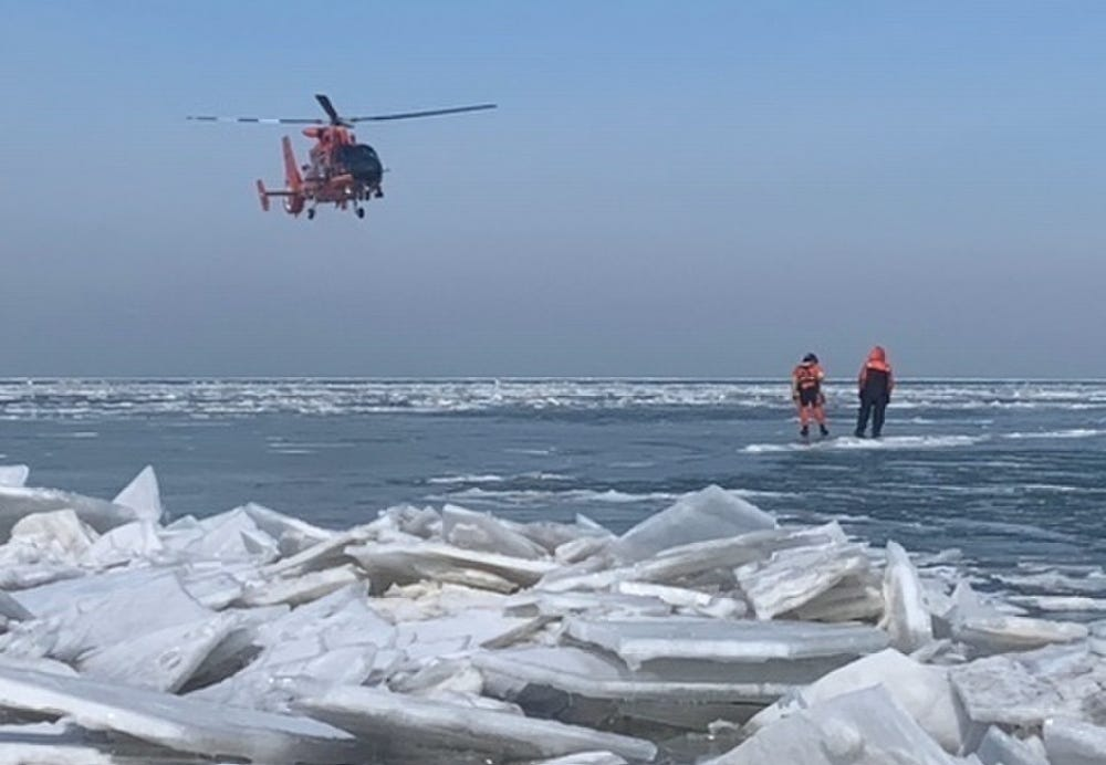 A helicopter from Coast Guard Air Station Detroit assists with the mass rescue of 46 people from an ice floe near Catawaba Island, March 9, 2019. 46 people were rescued by Coast Guard and local agencies after an ice floe broke free from land.