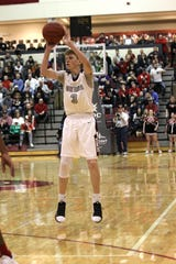 Genoa's Mike Rightnowar shoots a 3-pointer.