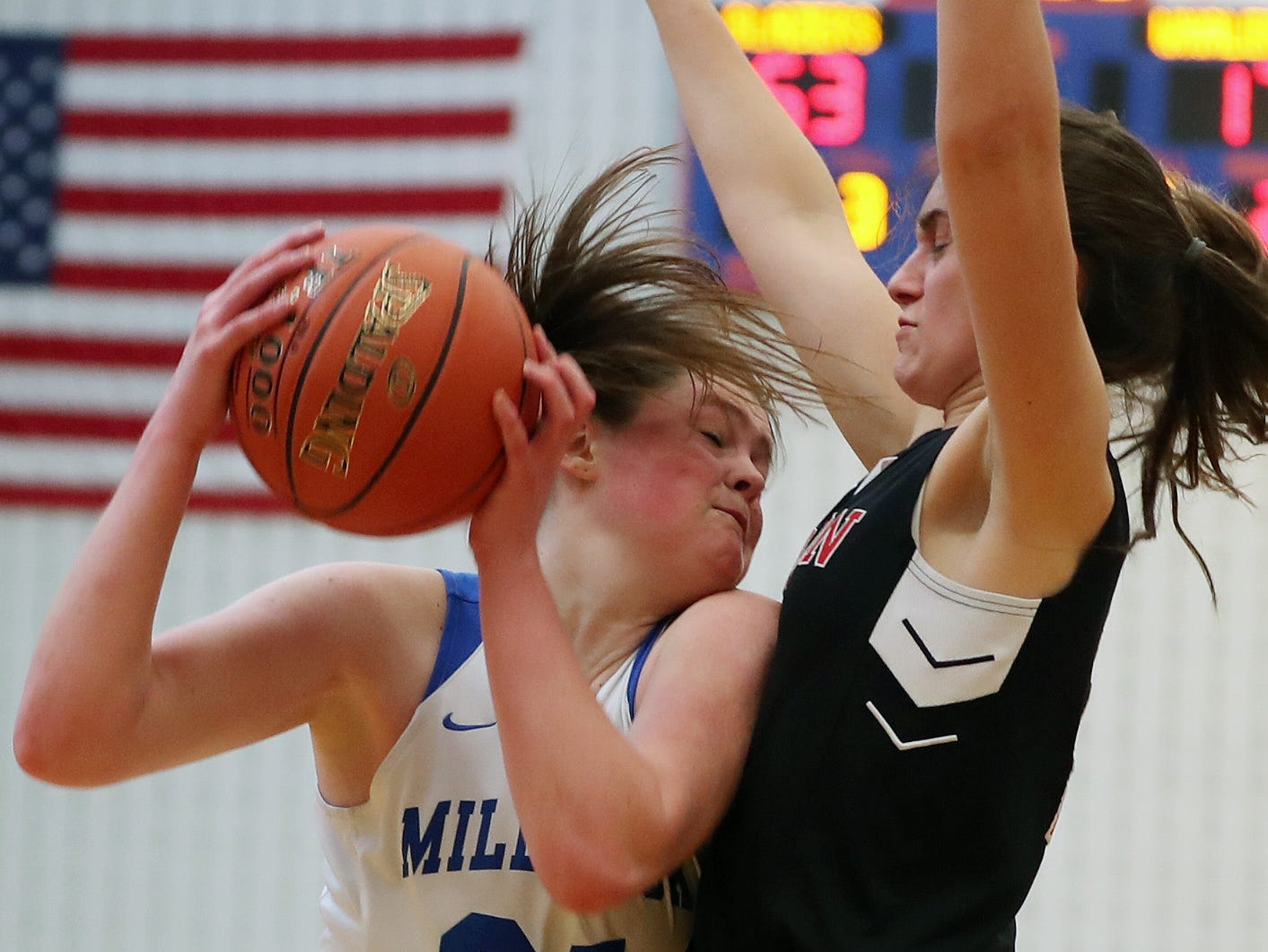 Millbrook's Erin Fox (21) drives to the basket in front of Pierson/Bridgehampton/Shelter Island's Katie Kneeland (2) during the girls regional final at SUNY New Paltz Match 9, 2019. Millbrook won the game.