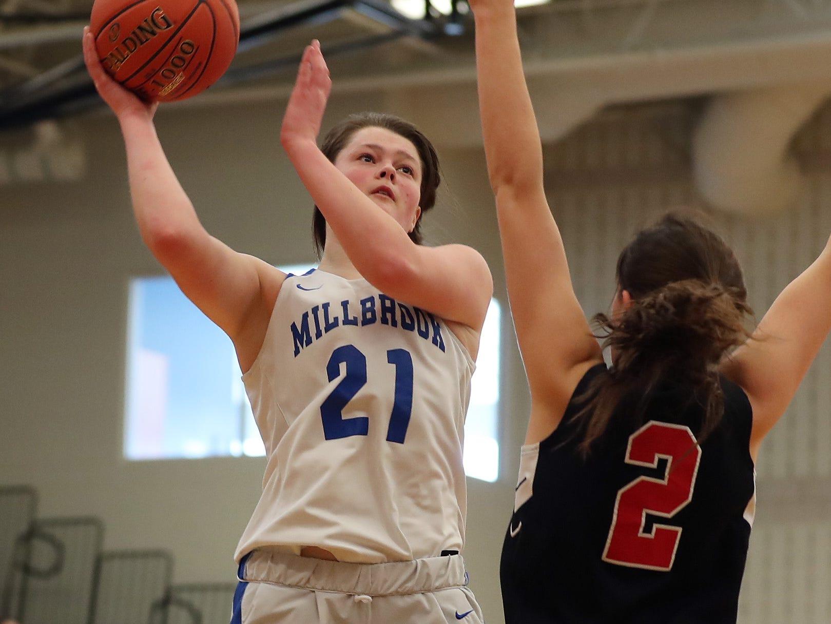 Millbrook's Erin Fox (21) puts up a shot against Pierson/Bridgehampton/Shelter Island during the girls regional final at SUNY New Paltz Match 9, 2019.