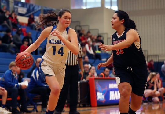 Millbrook's Natalie Fox drives to the basket against Pierson/Bridgehampton/Shelter Island during the Class C girls basketball regional final on March 9.