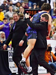 Northern York's Kyle Swartz celebrates after winning the PIAA Class 3-A state championship at 195 pounds in the Giant Center in Hershey on Saturday, March 9, 2019. Dawn J. Sagert photo