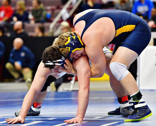 Dallastown's Raymond Christas, left, wrestles Mt. Lebanon's Nathan Goaglund in the 285 pound weight class during PIAA 3A Individual Wrestling Championships fifth place match at Giant Center in Hershey, Saturday, March 9, 2019. Christas would win the match by decision 3-0. Dawn J. Sagert photo