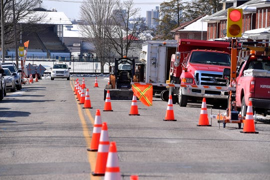 A vehicle rolls past the SmartFlagger on a Kinsley construction site on Florida Avenue, Thursday, March 7, 2019. John A. Pavoncello photo