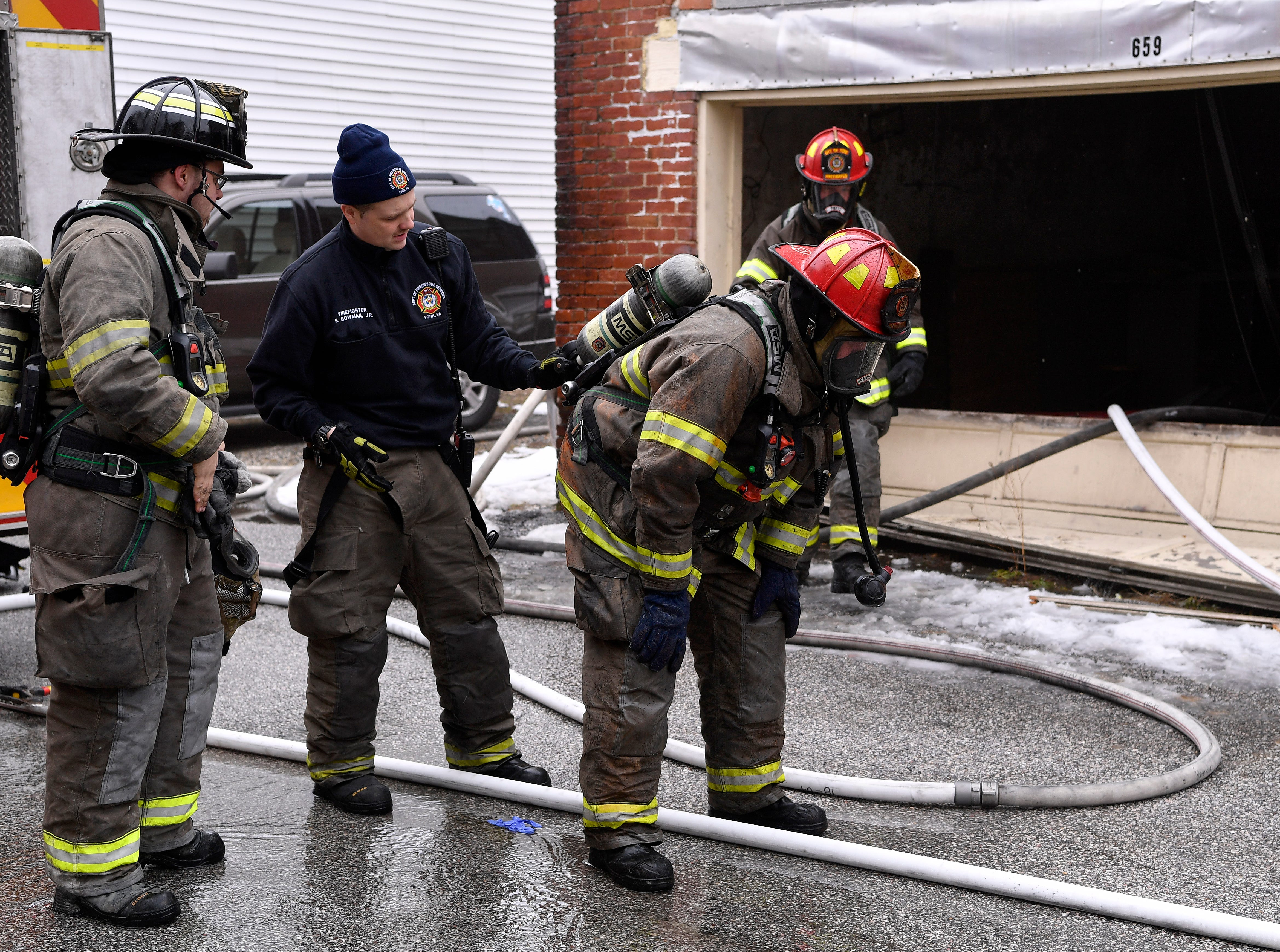 Firefighters battle a stubborn blaze in a two-story garage in the 600 block of W. Philadelphia Street, Sunday, March 10, 2018.