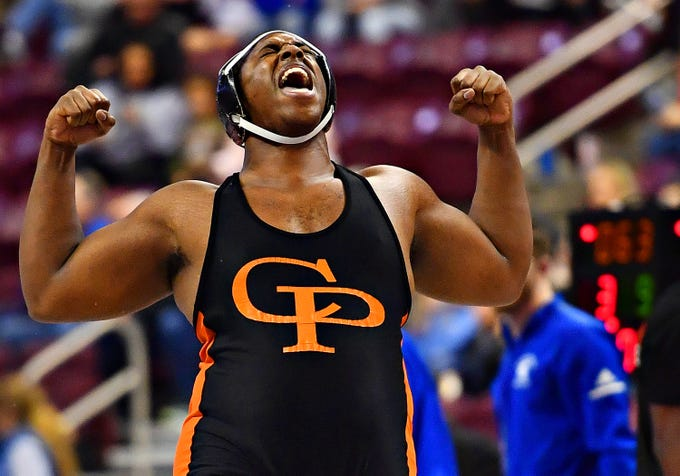 Cathedral Prep's Kawaun DeBoe celebrates a 3-1 win by decision over Upper St. Clair's Jake Slinger in the 285 pound weight class during PIAA 3A Individual Wrestling Championships match at Giant Center in Hershey, Saturday, March 9, 2019. Dawn J. Sagert photo