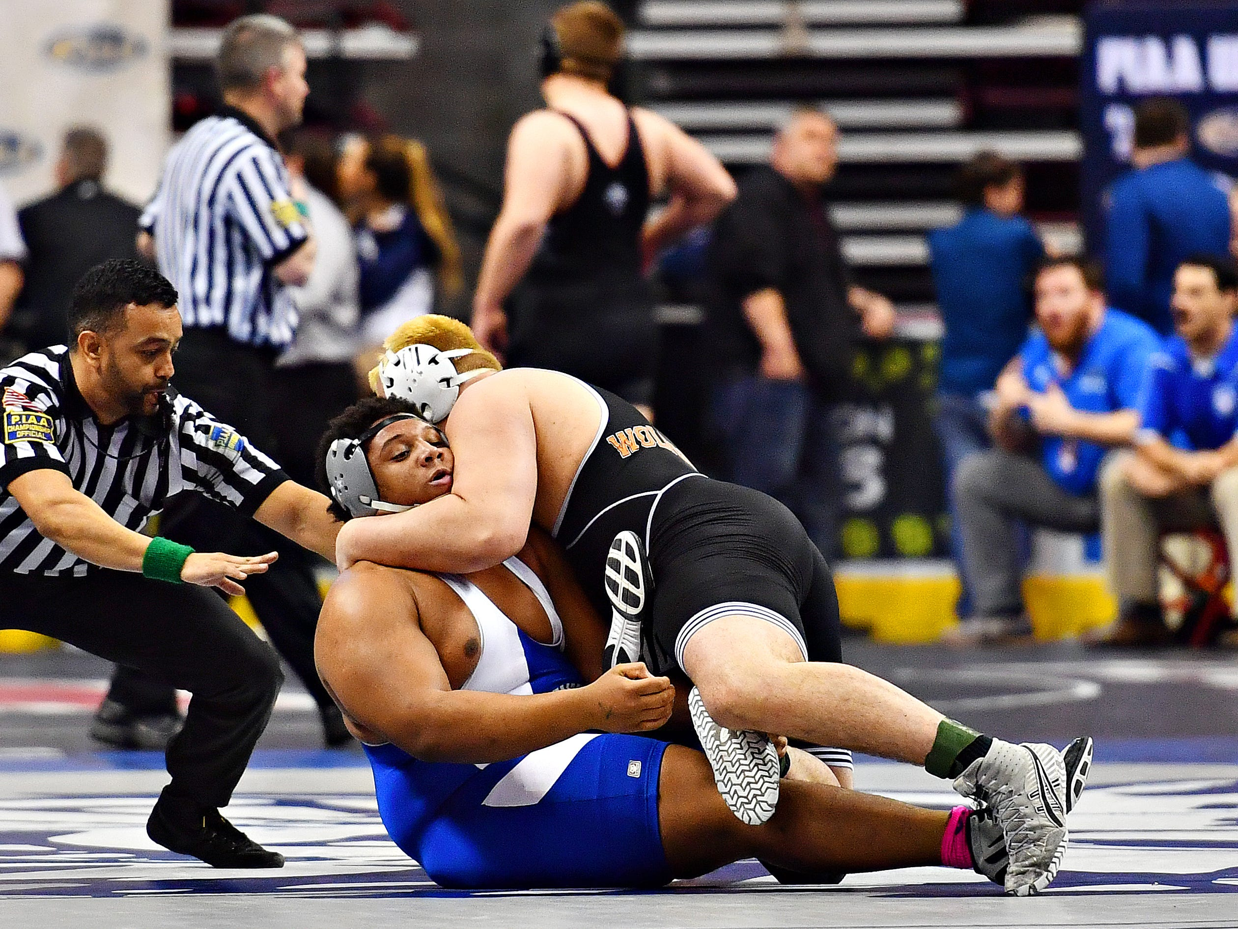 Central York's Michael Wolfgram, right, wrestles Hempfield's Isaiah Vance in the 285 pound weight class during PIAA 3A Individual Wrestling Championships third place match at Giant Center in Hershey, Saturday, March 9, 2019. Wolfgram would win the match 9-3. Dawn J. Sagert photo