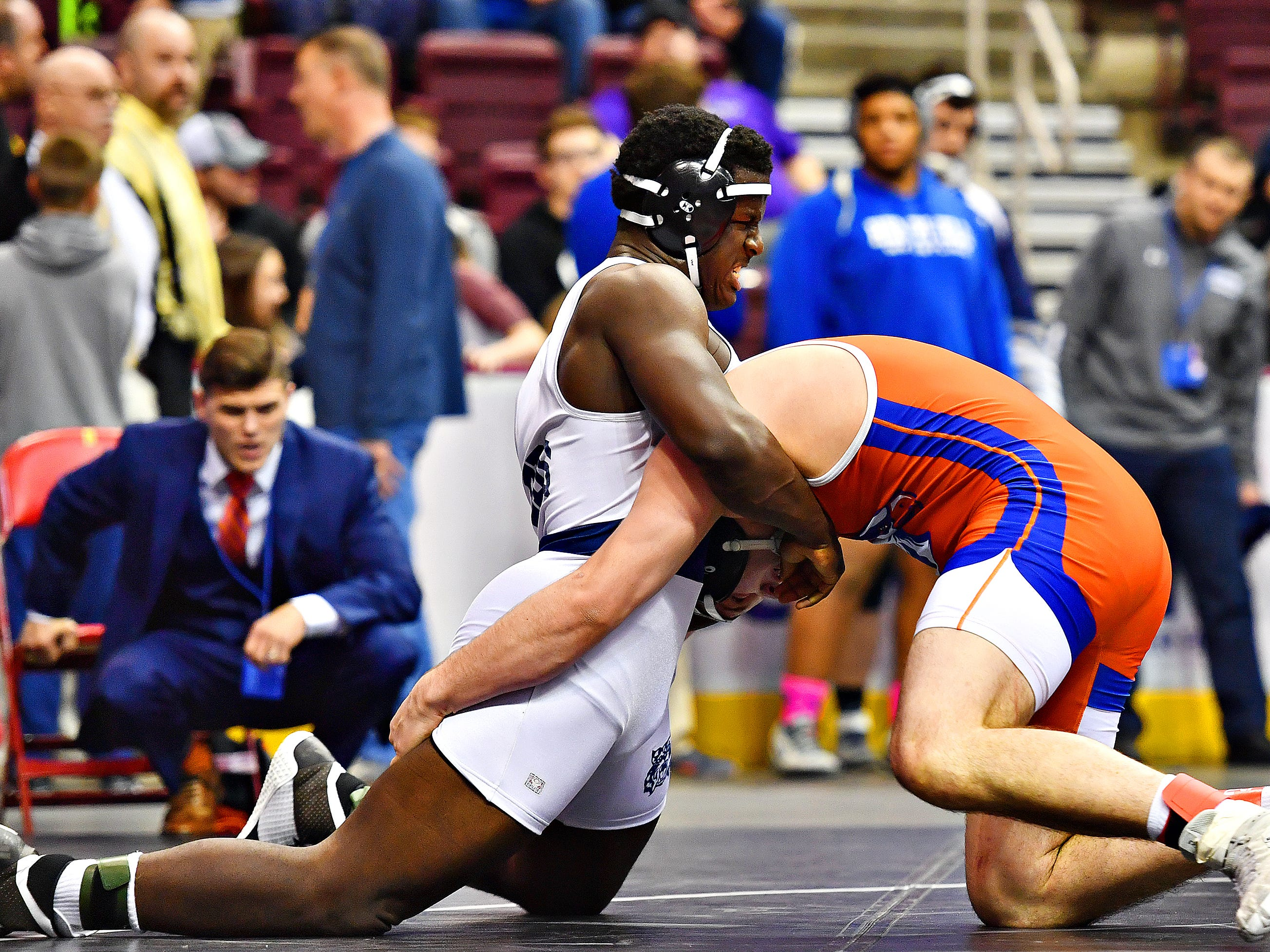 Dallastown's Jamal Brandon, left, wrestles Armstrong's Ogden Atwood in the 220 pound weight class during PIAA 3A Individual Wrestling Championships seventh place match at Giant Center in Hershey, Saturday, March 9, 2019. Brandon would win by decision 6-5. Dawn J. Sagert photo