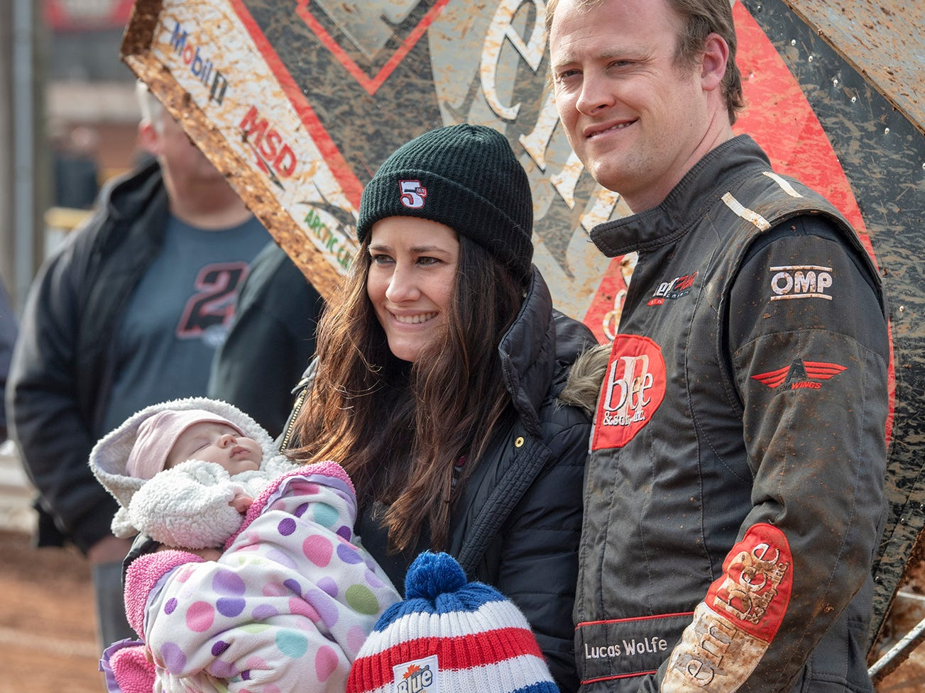 Lucas Wolfe, right, driving the 24 car won the Lincoln Speedway Ice Breaker 30 on Sunday near Abbottstown. He stands with his wife Tasha and children Vera, age 4, and Vivienne, age 2.