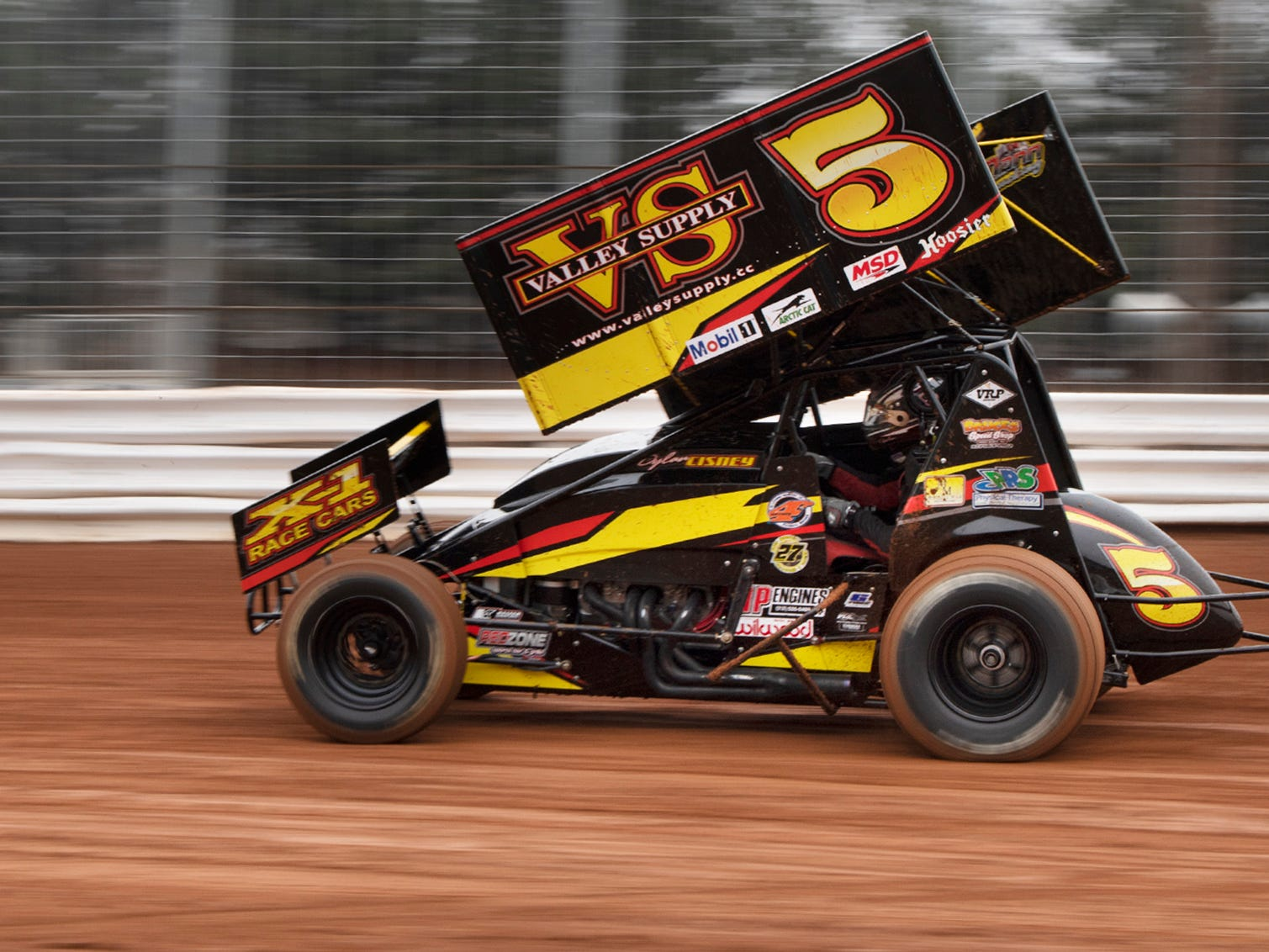 The number 5 car driven by Dylan Cisney blurs down a strait-away during the Lincoln Speedway Ice Breaker 30 on Sunday near Abbottstown.
