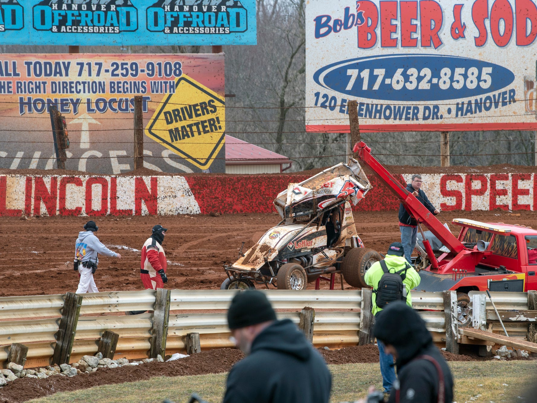 Freddie Rahmer's 51 car is towed away after a crash in the fourth turn of the 16th lap during the Lincoln Speedway Ice Breaker 30 on Sunday near Abbottstown.