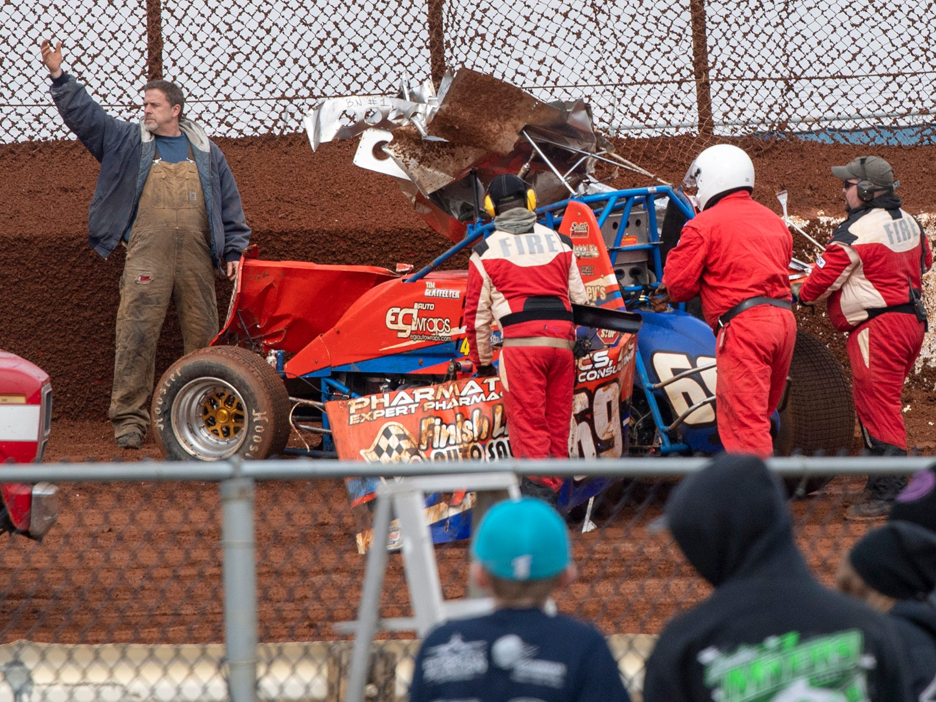 The 69 car driven by Tim Glatfelter is taken away during a crash in the second turn during the final laps of the Lincoln Speedway Ice Breaker 30 on Sunday near Abbottstown.
