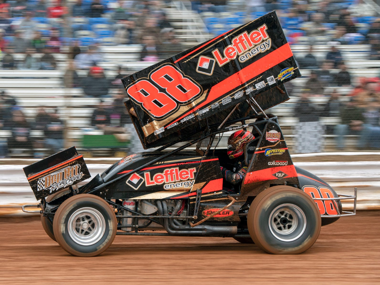 The 88 car driven by Brandon Rahmer streaks past the fans during the Lincoln Speedway Ice Breaker 30 on Sunday near Abbottstown.