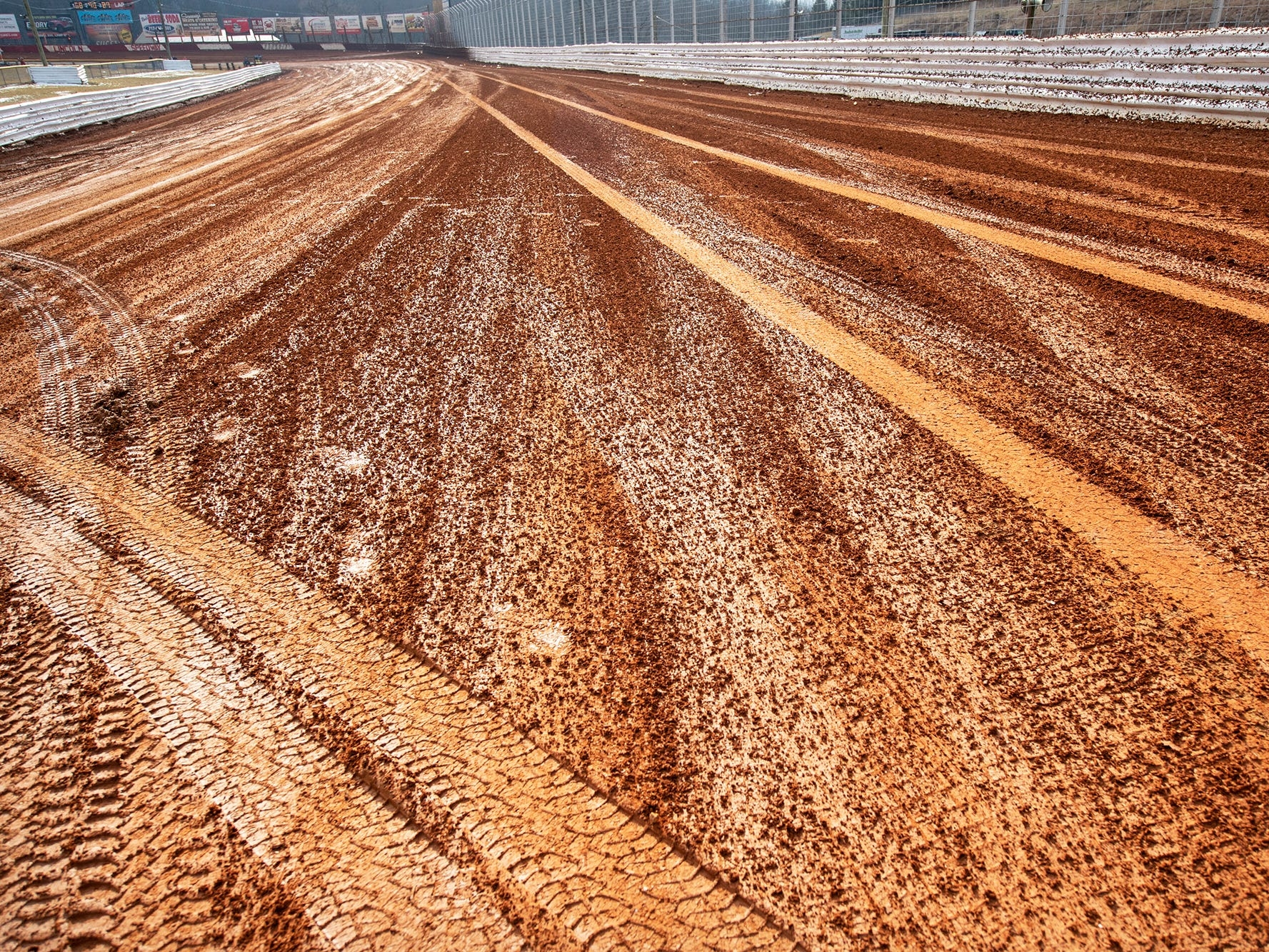 Tire tracks and spattered mud coat the clay track after the Lincoln Speedway Ice Breaker 30 on Sunday near Abbottstown.