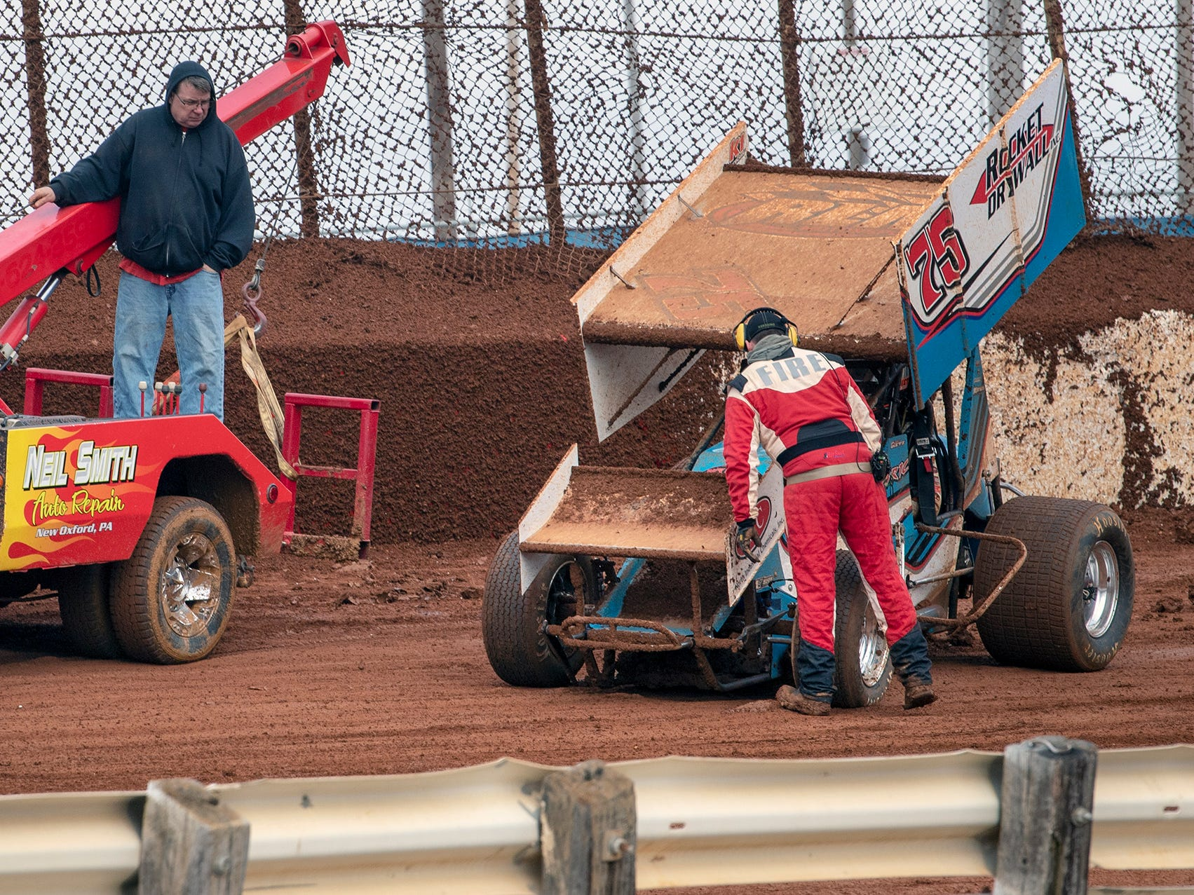 The 75 car driven by Chase Dietz is towed away after a crash during final laps of the Lincoln Speedway Ice Breaker 30 on Sunday near Abbottstown.