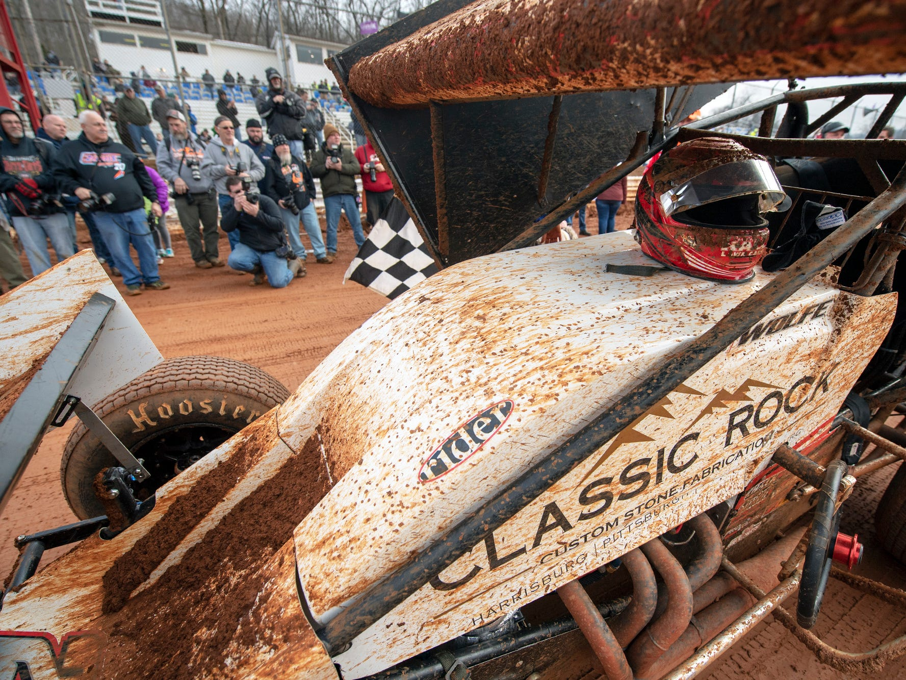 Lucas Wolfe's mud spattered car as he takes the checkered flag winning the the Lincoln Speedway Ice Breaker 30 on Sunday near Abbottstown.