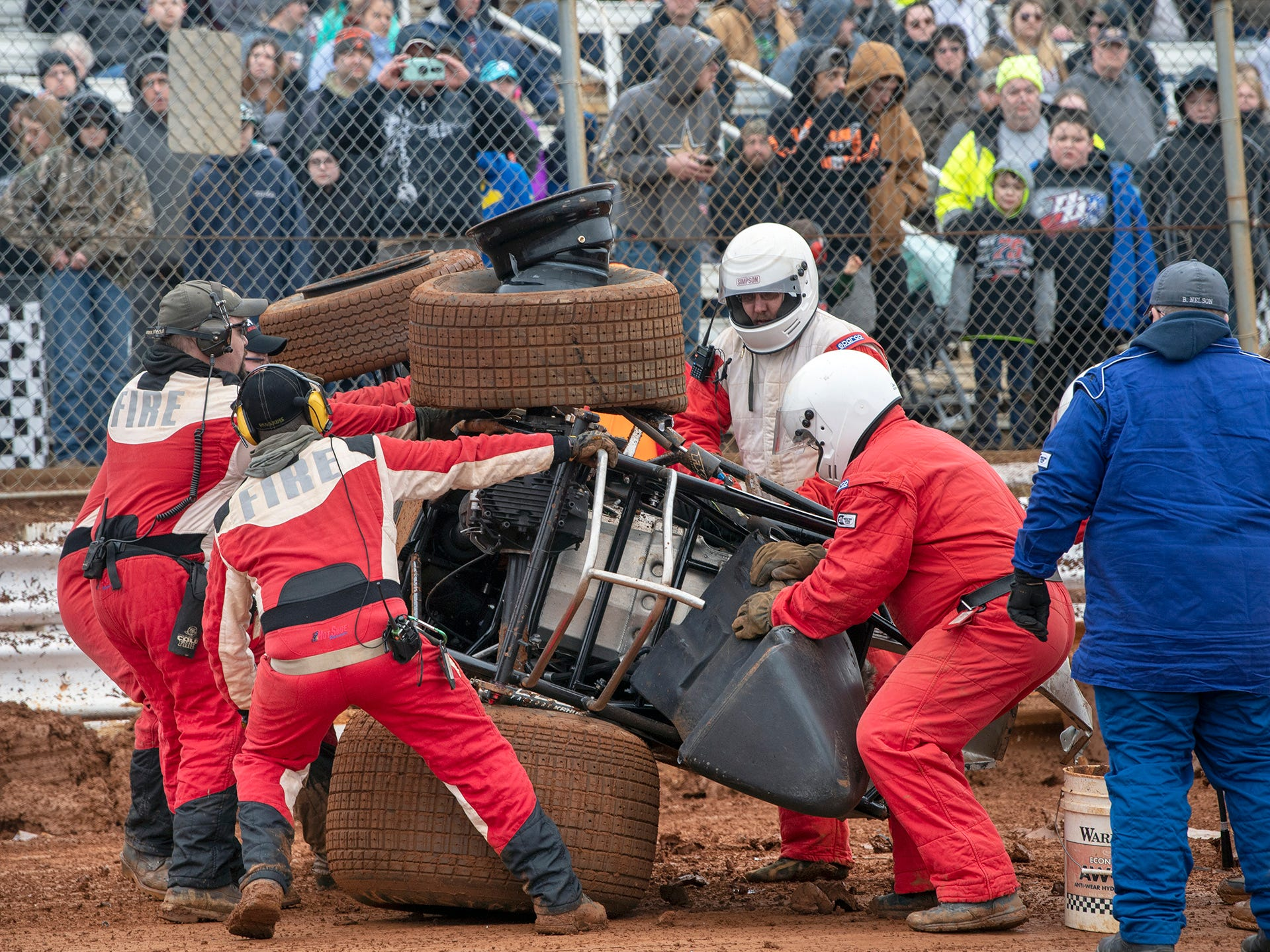 The number 12 car driven by Tyler Esh is rolled back over after a crash in front of spectators during the Lincoln Speedway Ice Breaker 30 on Sunday near Abbottstown.