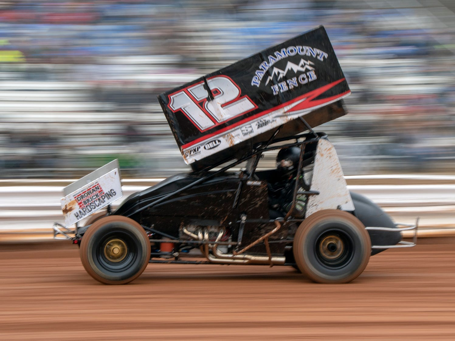 The number 12 car driven by Tyler Esh streaks past the crowd during the Lincoln Speedway Ice Breaker 30 on Sunday near Abbottstown.