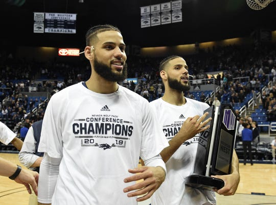 The Martin twins walk off the Lawlor Events Center floor with the Mountain West championship trophy following Saturday night's win over San Diego State.
