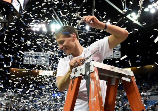 Nevada head coach Eric Musselman celebrate the Wolf Pack's Mountain West title after Nevada beat San Diego State on Saturday at Lawlor Events Center.