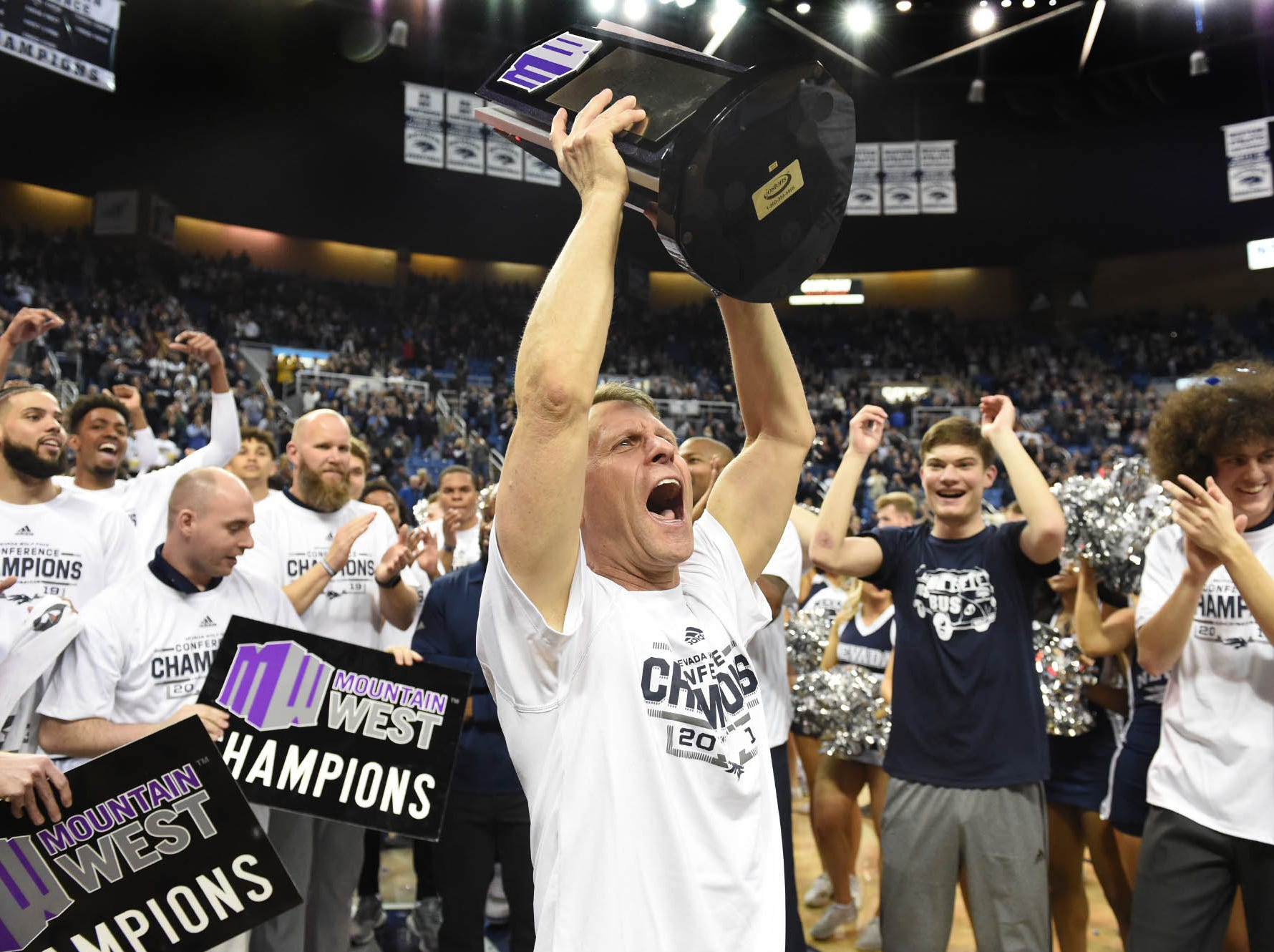 The Wolf Pack celebrates a Mountain West title after defeating San Diego State 81-53 on Senior Night at Lawlor Events Center on Saturday March 9, 2019.