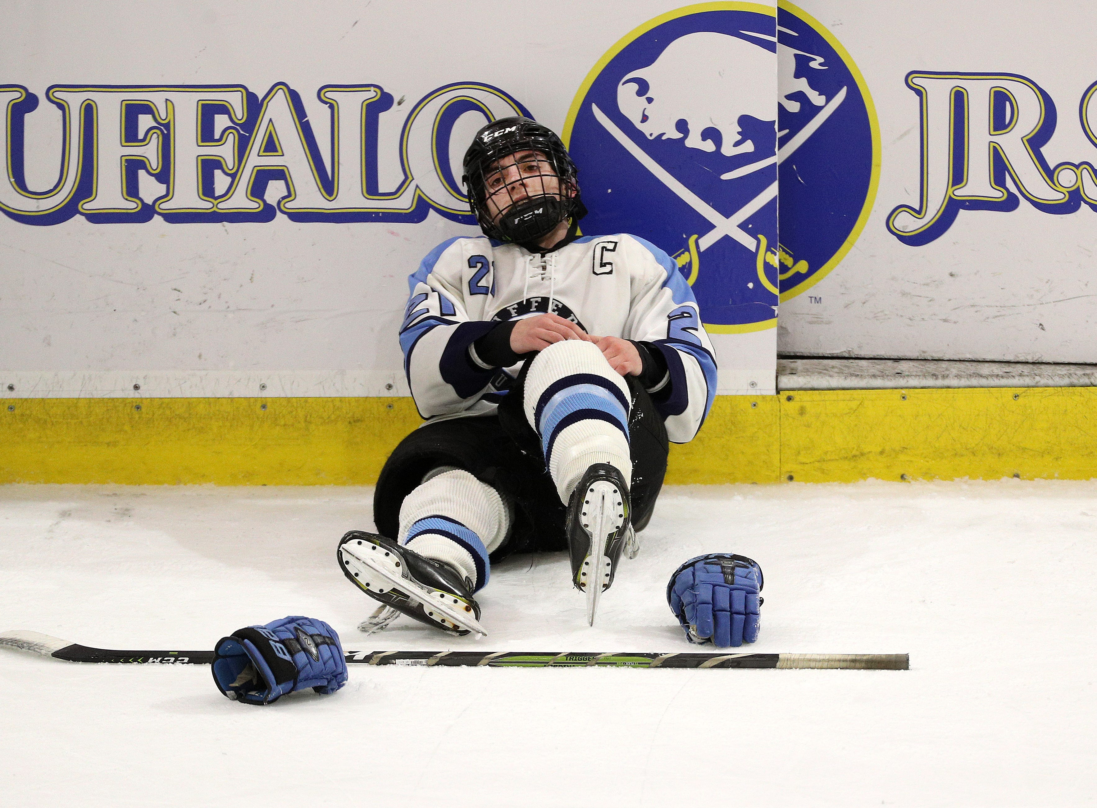 Suffern's Kyle Foresta sits dejected on the ice after the Mounties fell to Syracuse 4-2 in the Division l state final.