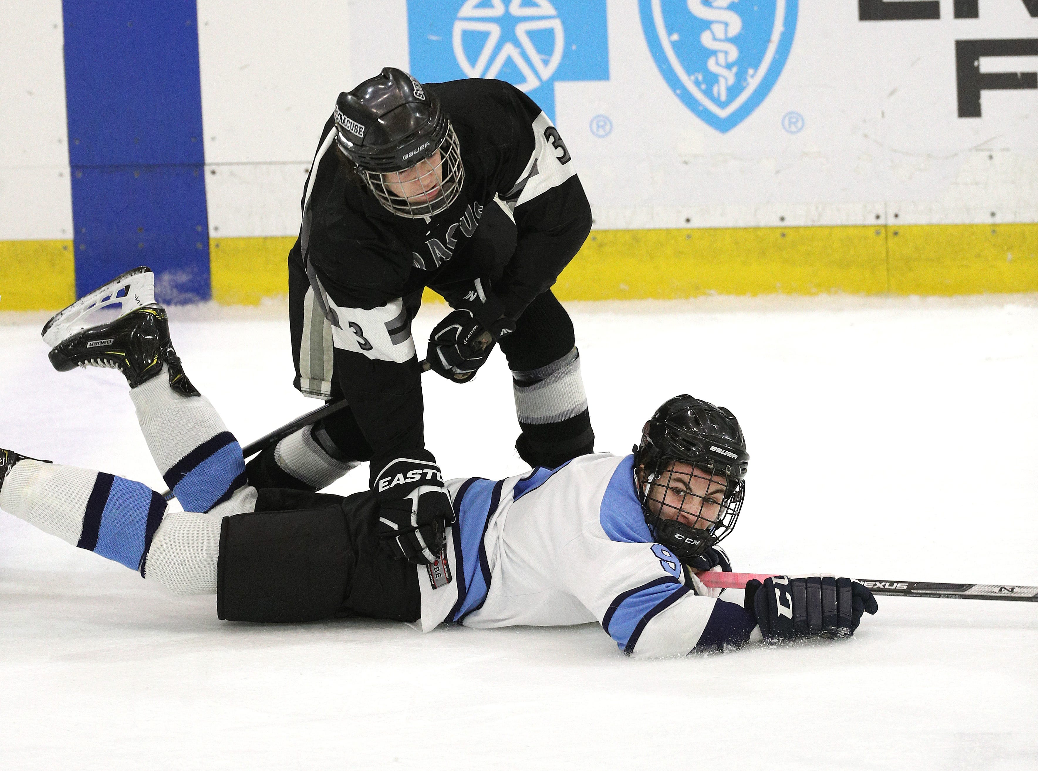 Suffern's Max Werfel is dumped near the blue line by Syracuse's Kyle Lamson.
