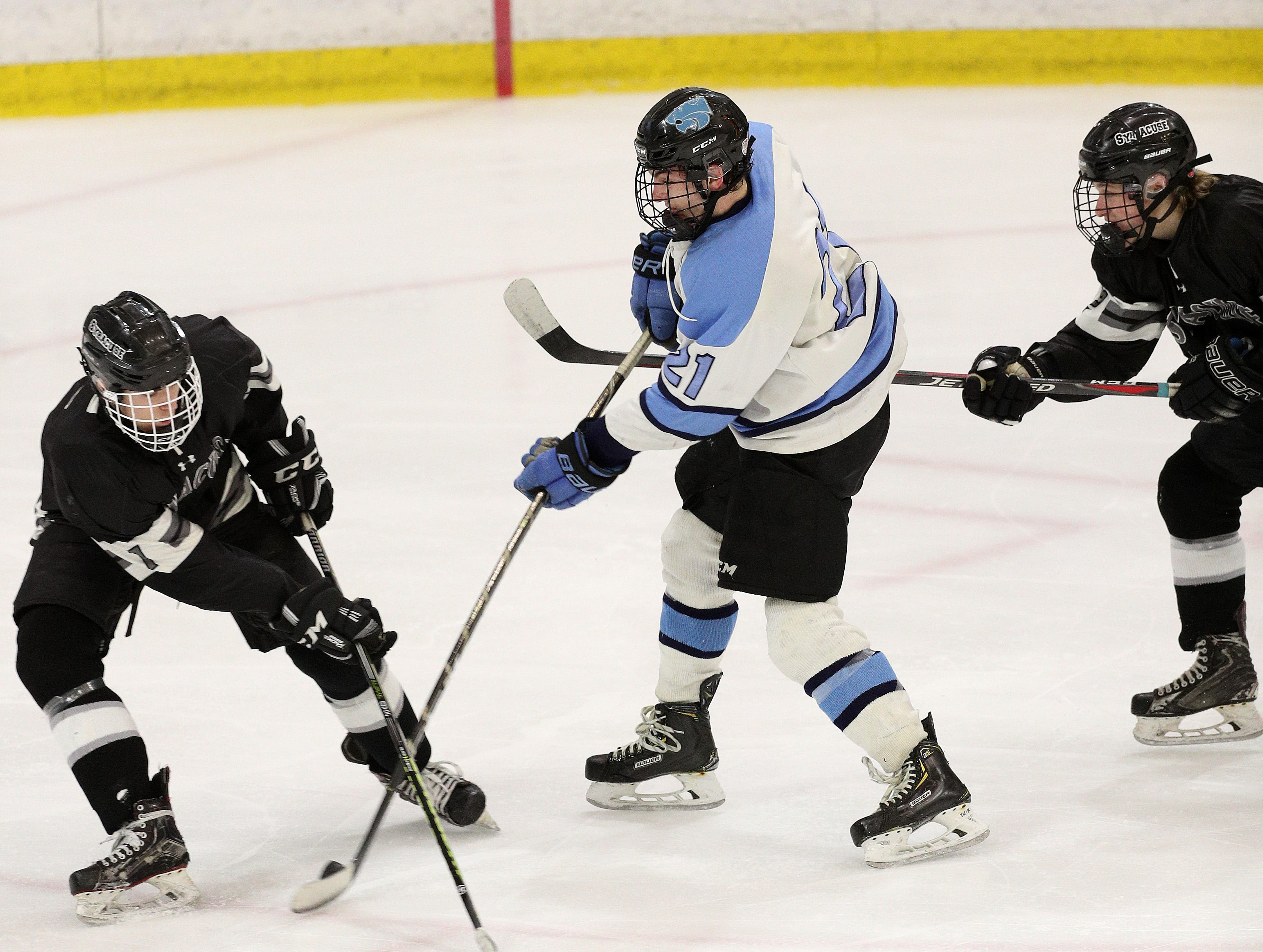 Suffern's Kyle Foresta gets off a shot in traffic against Syracuse.