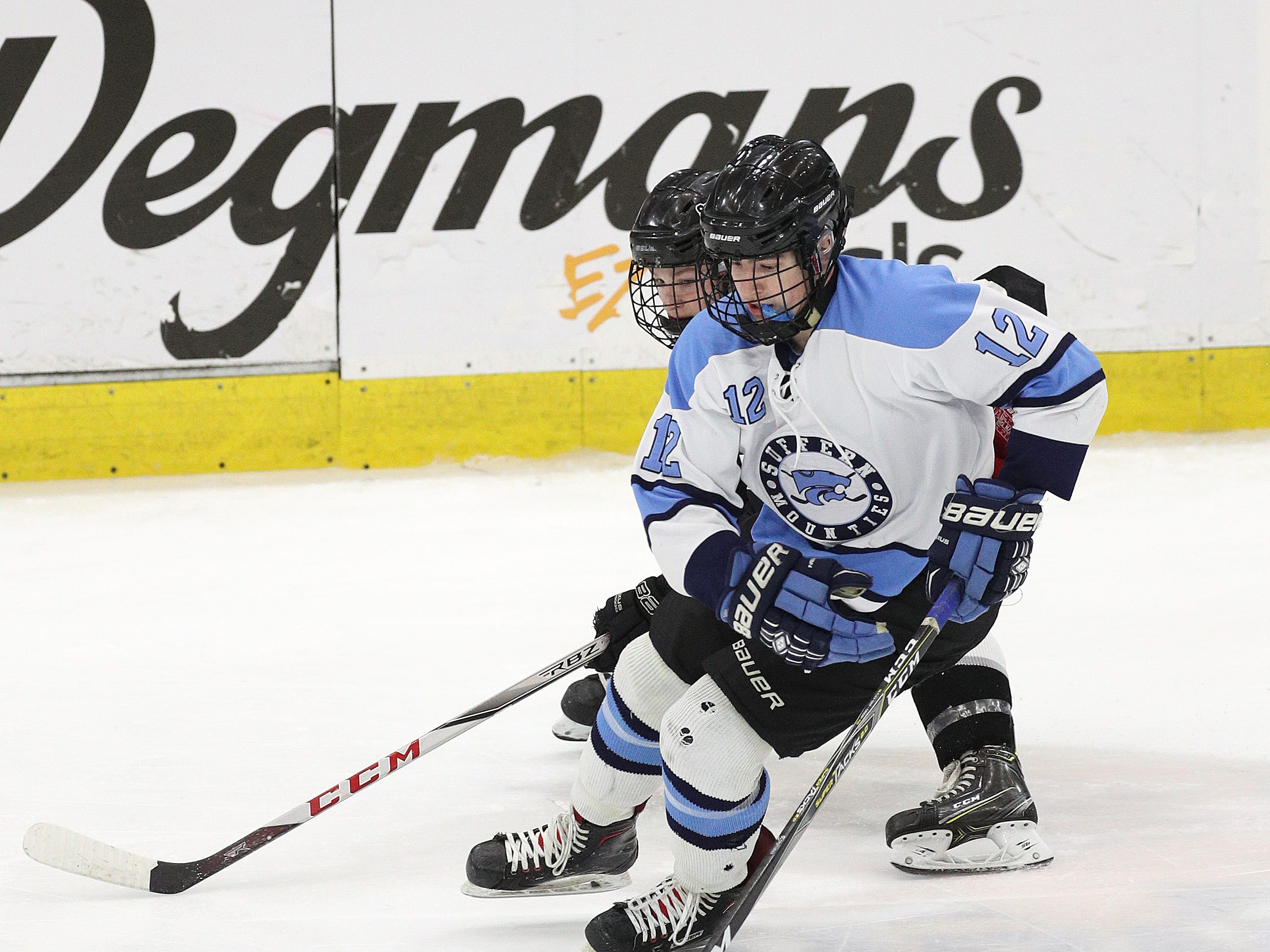 Suffern's Chris Olsen carries the puck up the ice.