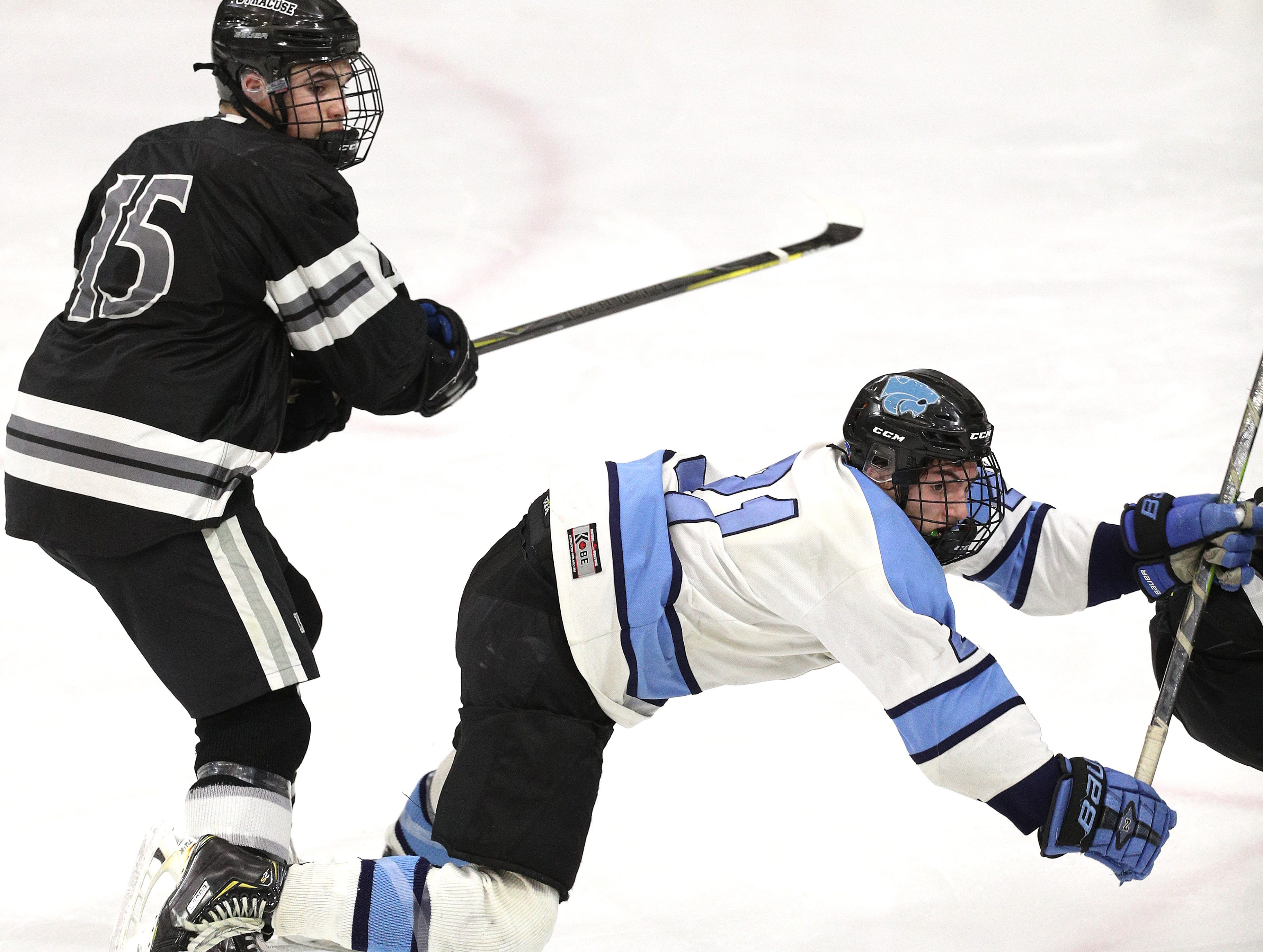 Suffern's Kyle Foresta is checked by Syracuse's Zachary Delaney.