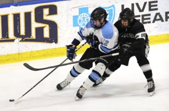 Suffern's Chris Olson is checked by Syracuse's Shemar Thomas.