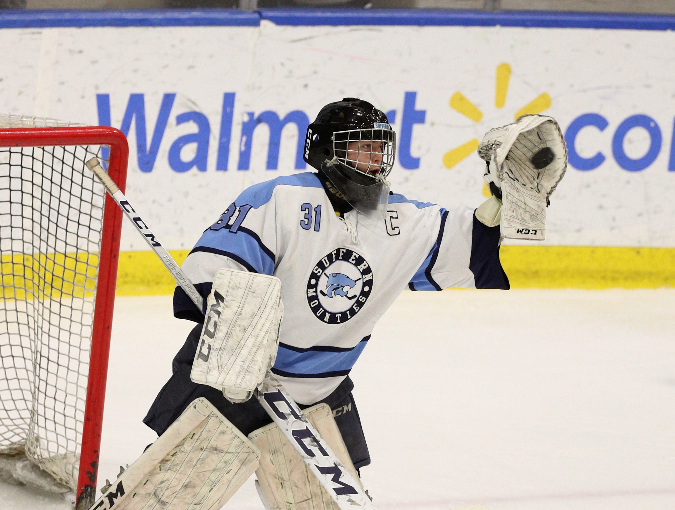 Surrern goalie Mike Harper makes a glove save.