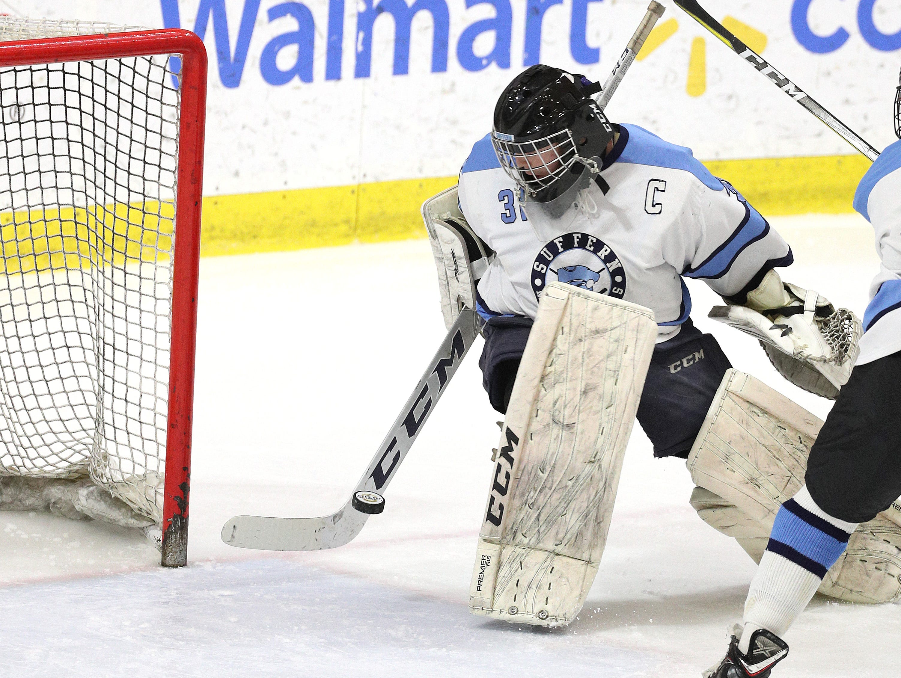 Suffern goalie Mike Harper finds a loose puck that got behind him in the division l final.