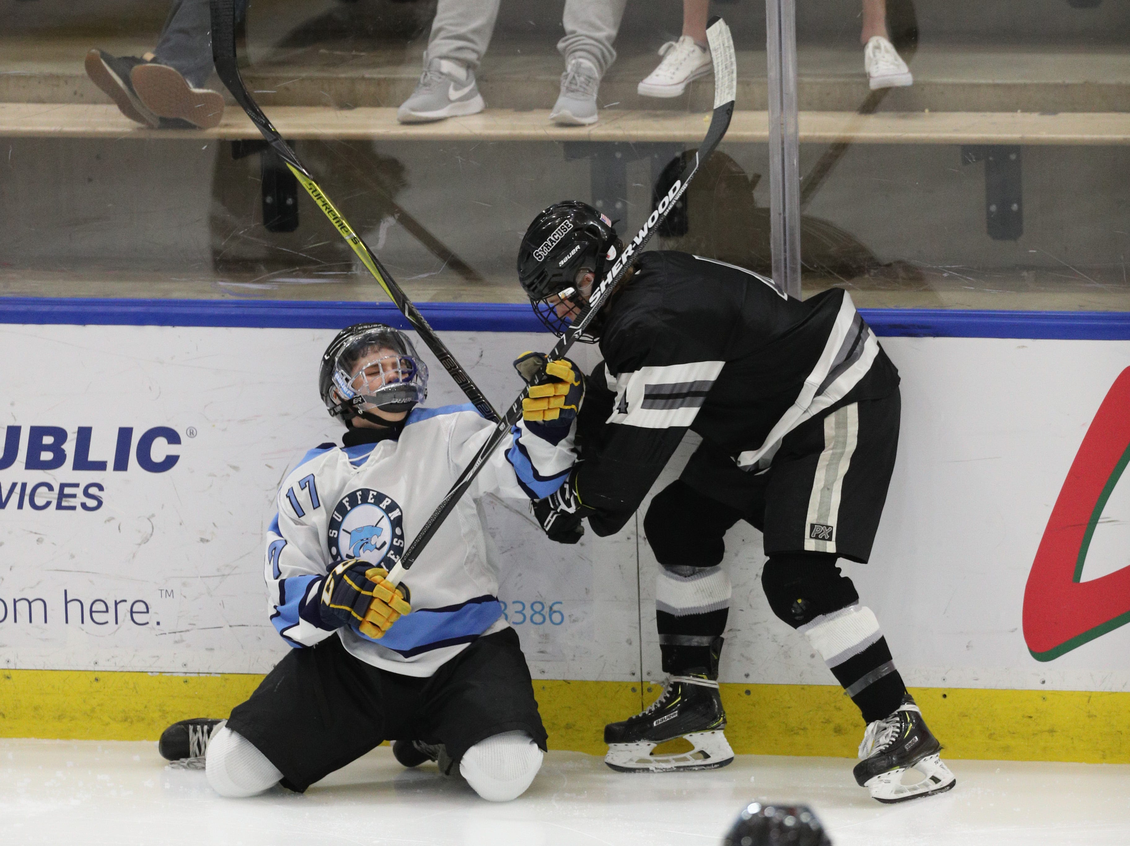 Suffern's Ben Burns (17) tries to play the puck away from Syracuse's Nathan Frye.