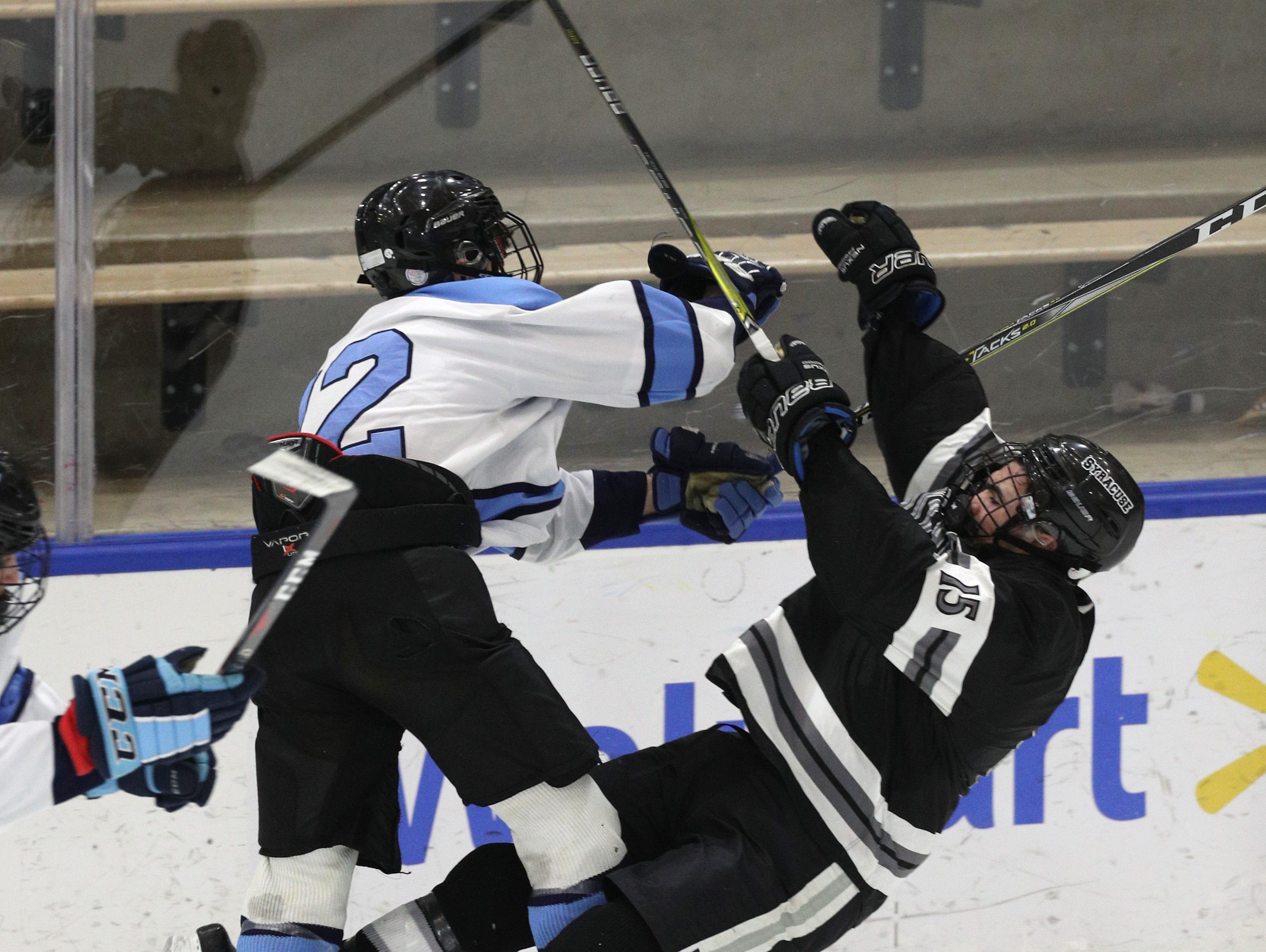 Suffern's Chris Olsen gets a big check on Syracuse's Zachary Delaney.