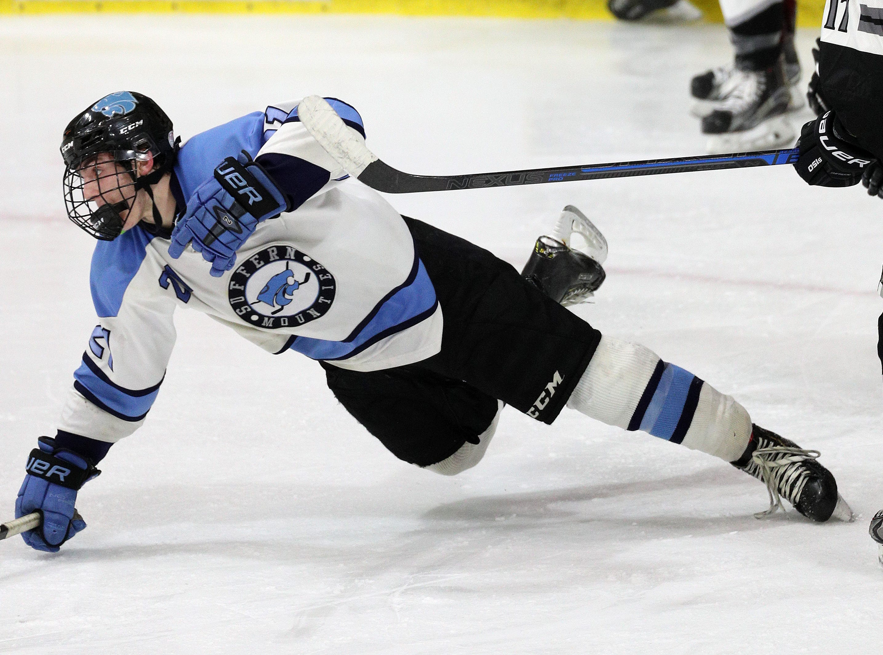 Suffern's Kyle Foresta is taken to the ice and draws an interference call against Syracuse.