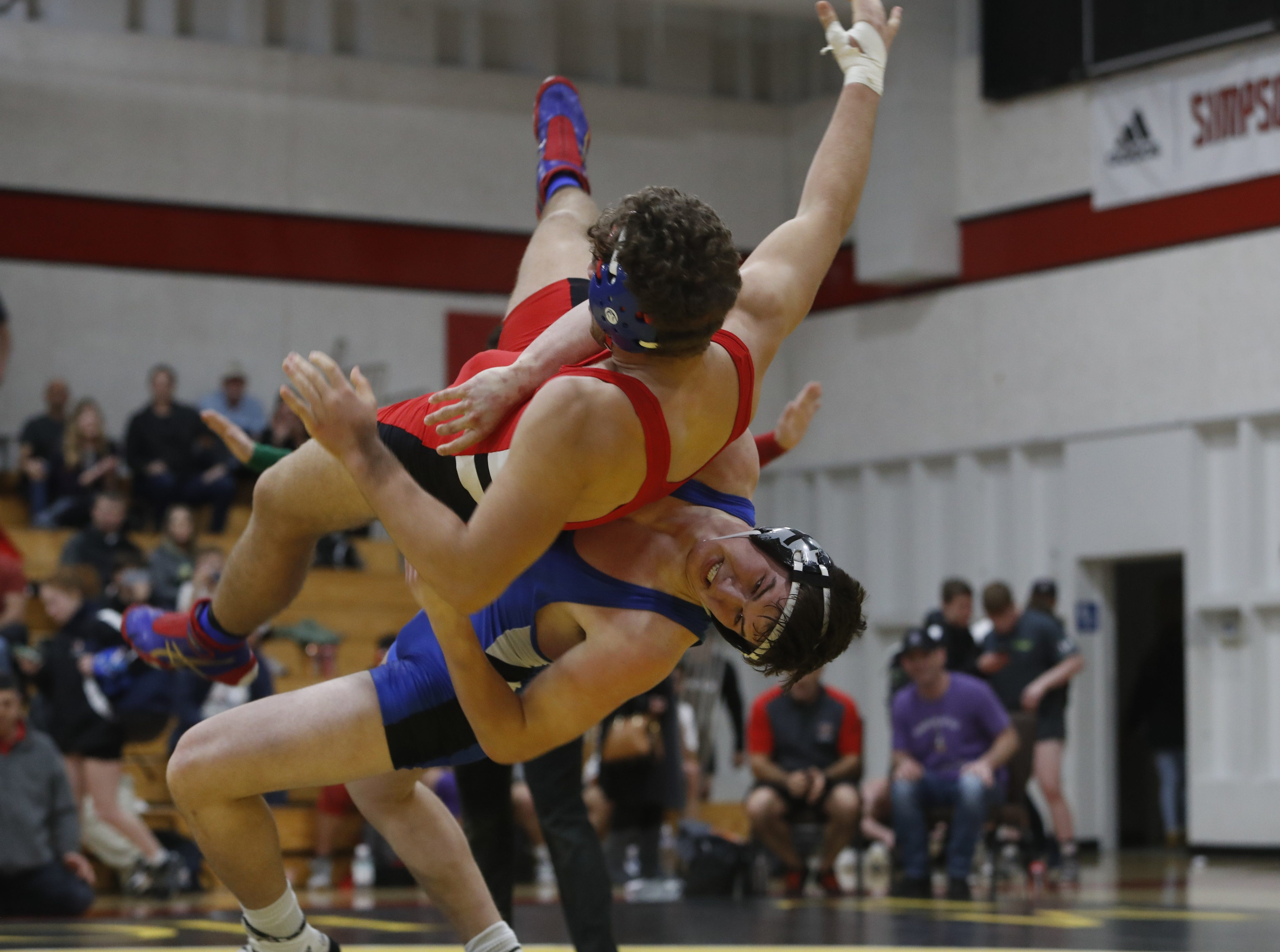 California's Reagan Dahle of Big Valley (right) takes down Oregon's Kianush Behbehani-Escobar of Westview at the ORCA Senior All-Star Duals at Simpson University on Saturday, March 9.