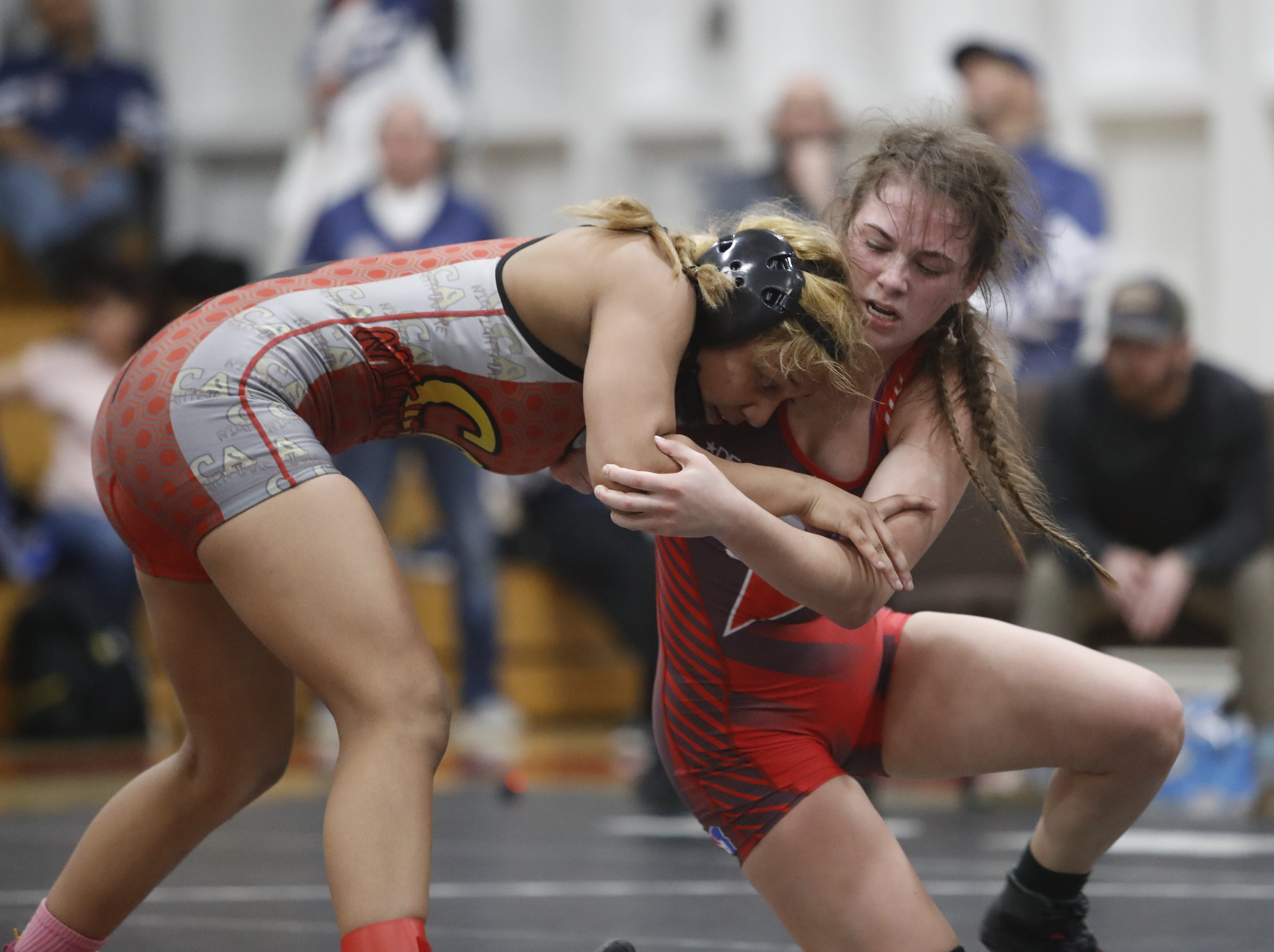 California's Jennifer Soto of Orland (left) wrestles against Oregon's Marissa Kurtz of Sweet Home at the ORCA Senior All-Star Duals at Simpson University on Saturday, March 9. Soto won the match with a 15-5 decision.