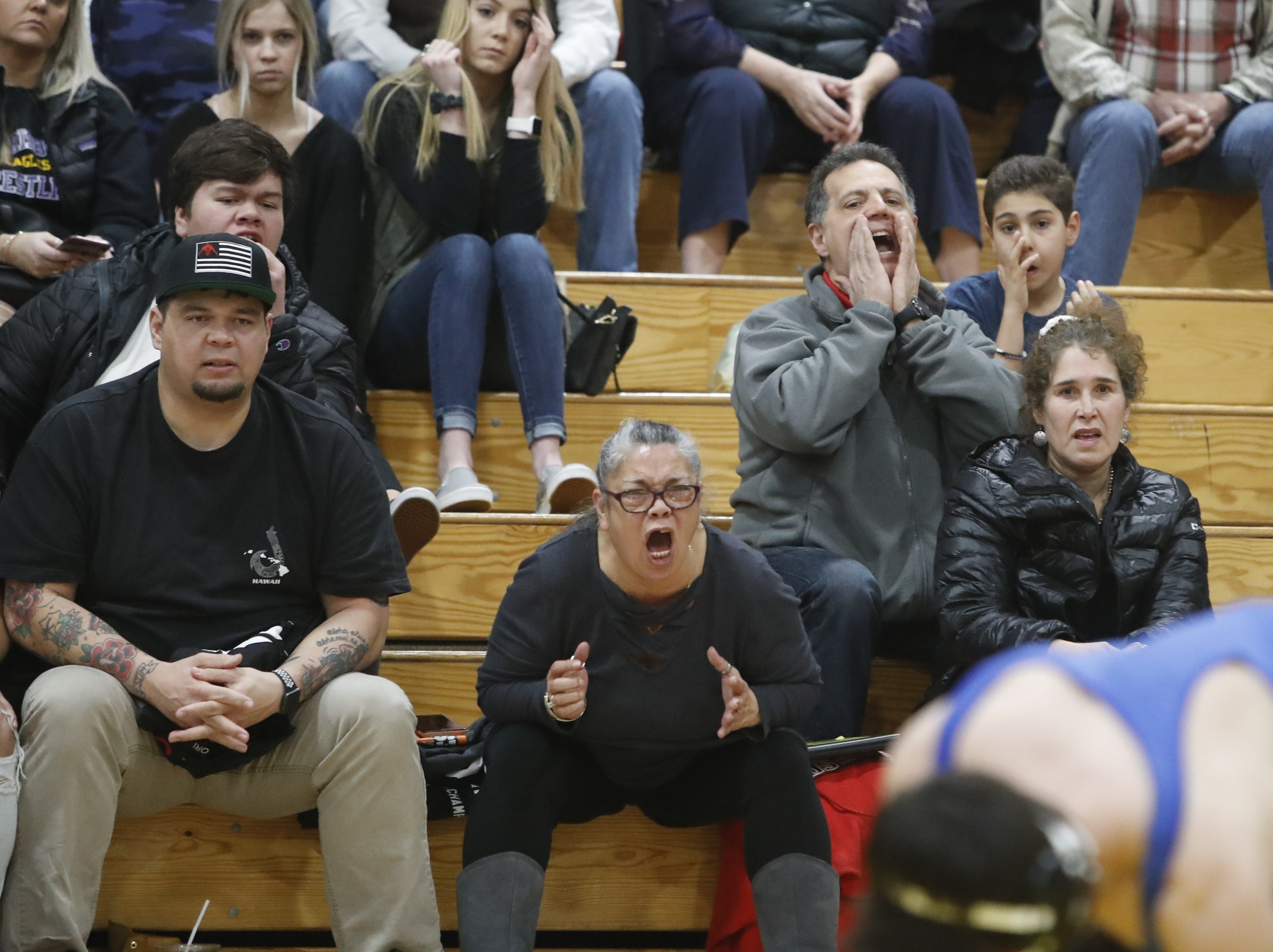 Fans watch California and Oregon wrestlers face off at the ORCA Senior All-Star Duals at Simpson University on Saturday, March 9.