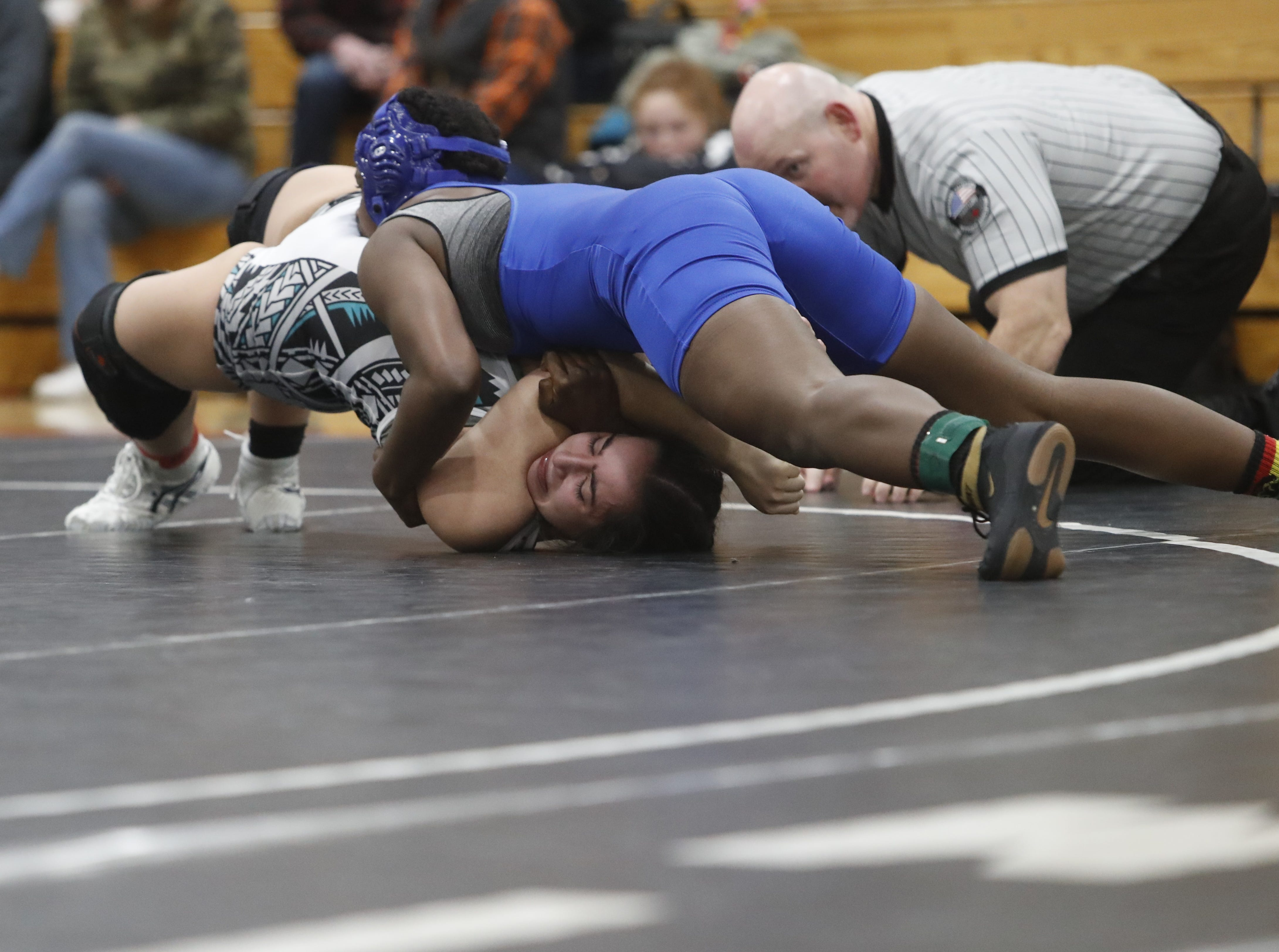 Oregon's Lillian Restrepo of Century (below) wrestles against California's Tia Barfield of Bishop Union at the ORCA Senior All-Star Duals at Simpson University on Saturday, March 9. Barfield won the match.