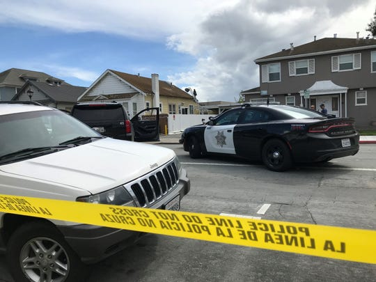 Salinas police plead with a man on a roof of a home in the 100 block of Central Avenue to come down in an hours long standoff Sunday.