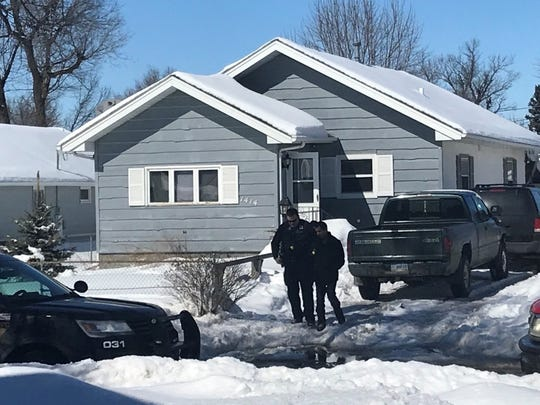 Sioux Falls police were called to this home, in the 1400 block of East 5th Street, Sunday at about 2 p.m. They arrested a suspect, under custody as pictured here, for aggravated assault in an incident involving a BB gun.