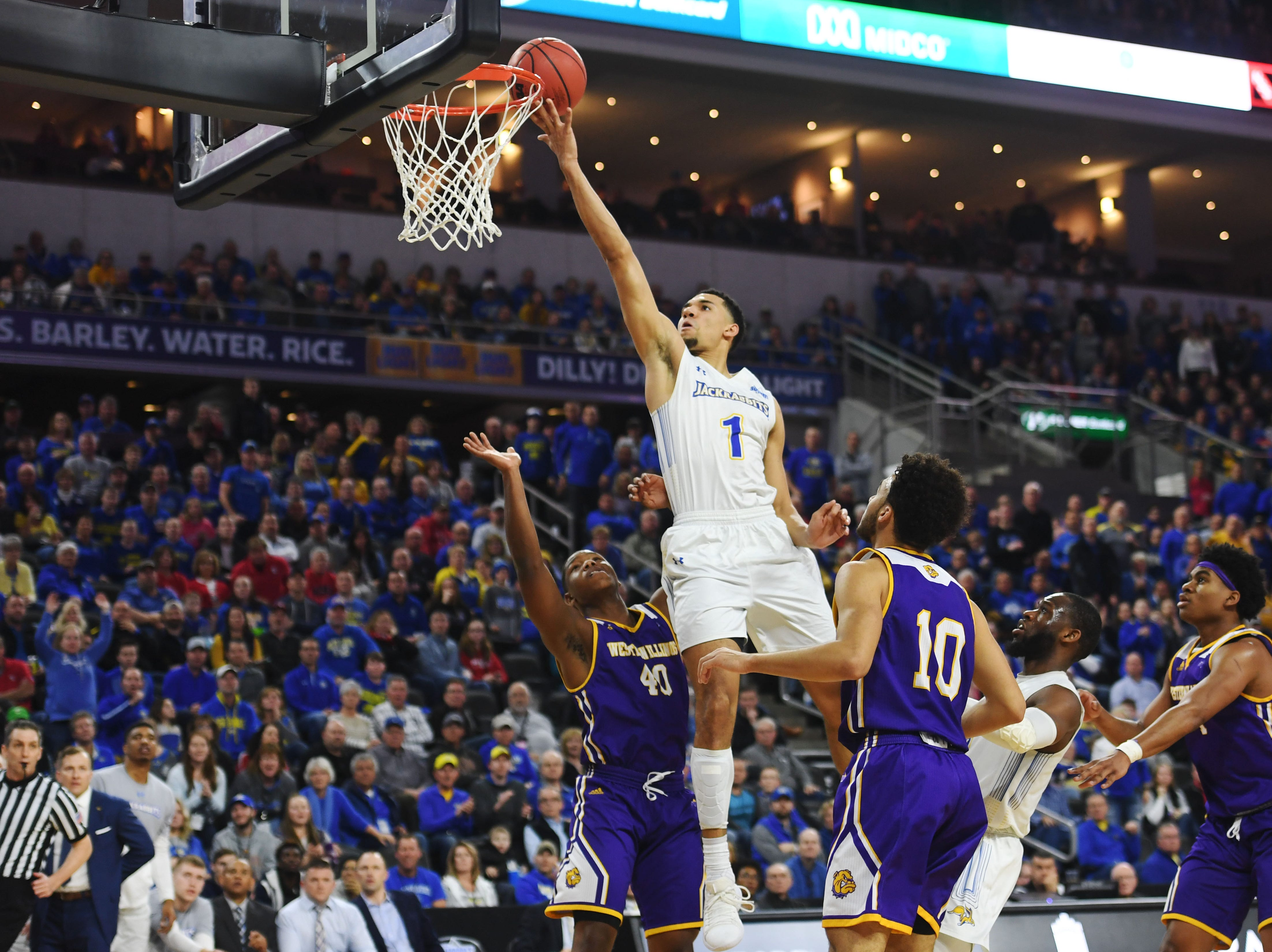 SDSU's Skyler Flatten scores against Western Illinois during the game Saturday, March 9, in the Summit League tournament at the Denny Sanford Premier Center in Sioux Falls.