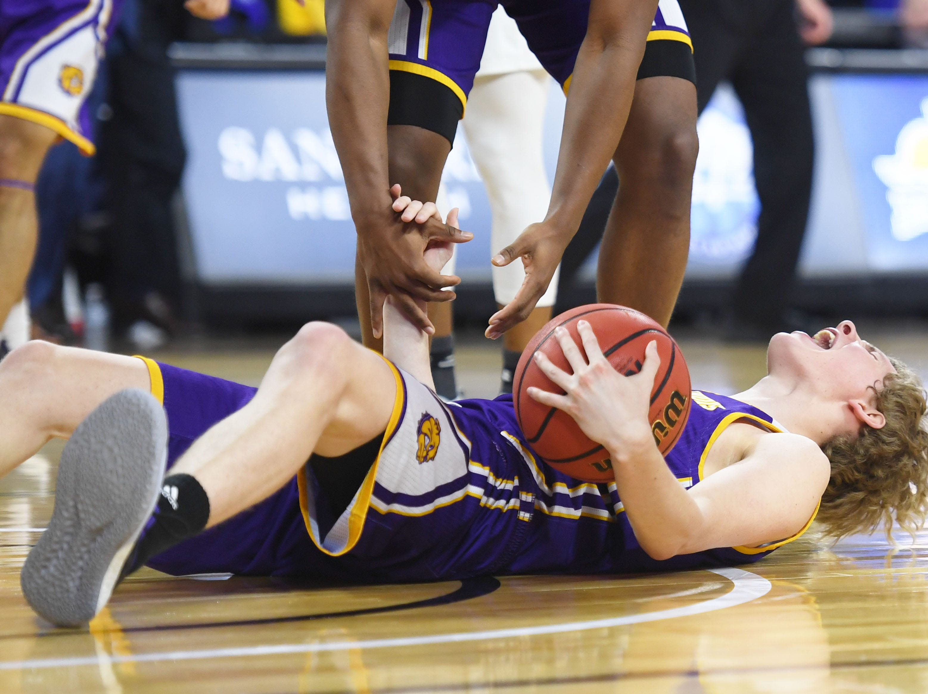Western Illinois' Ben Pyle lets out a yell after falling down during the game against SDSU Saturday, March 9, in the Summit League tournament at the Denny Sanford Premier Center in Sioux Falls.