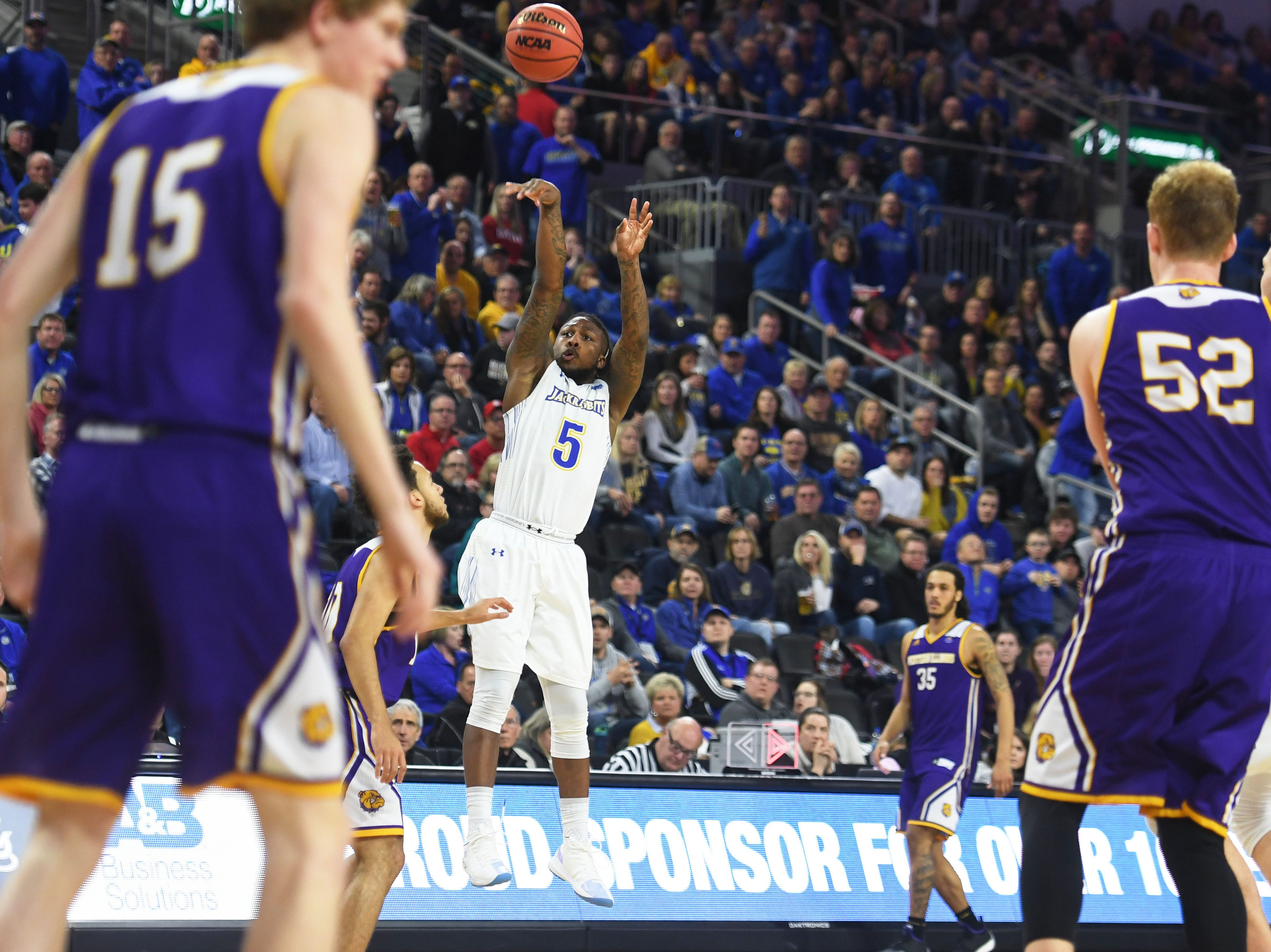 SDSU's David Jenkins scores a three pointer during the game against Western Illinois Saturday, March 9, in the Summit League tournament at the Denny Sanford Premier Center in Sioux Falls.